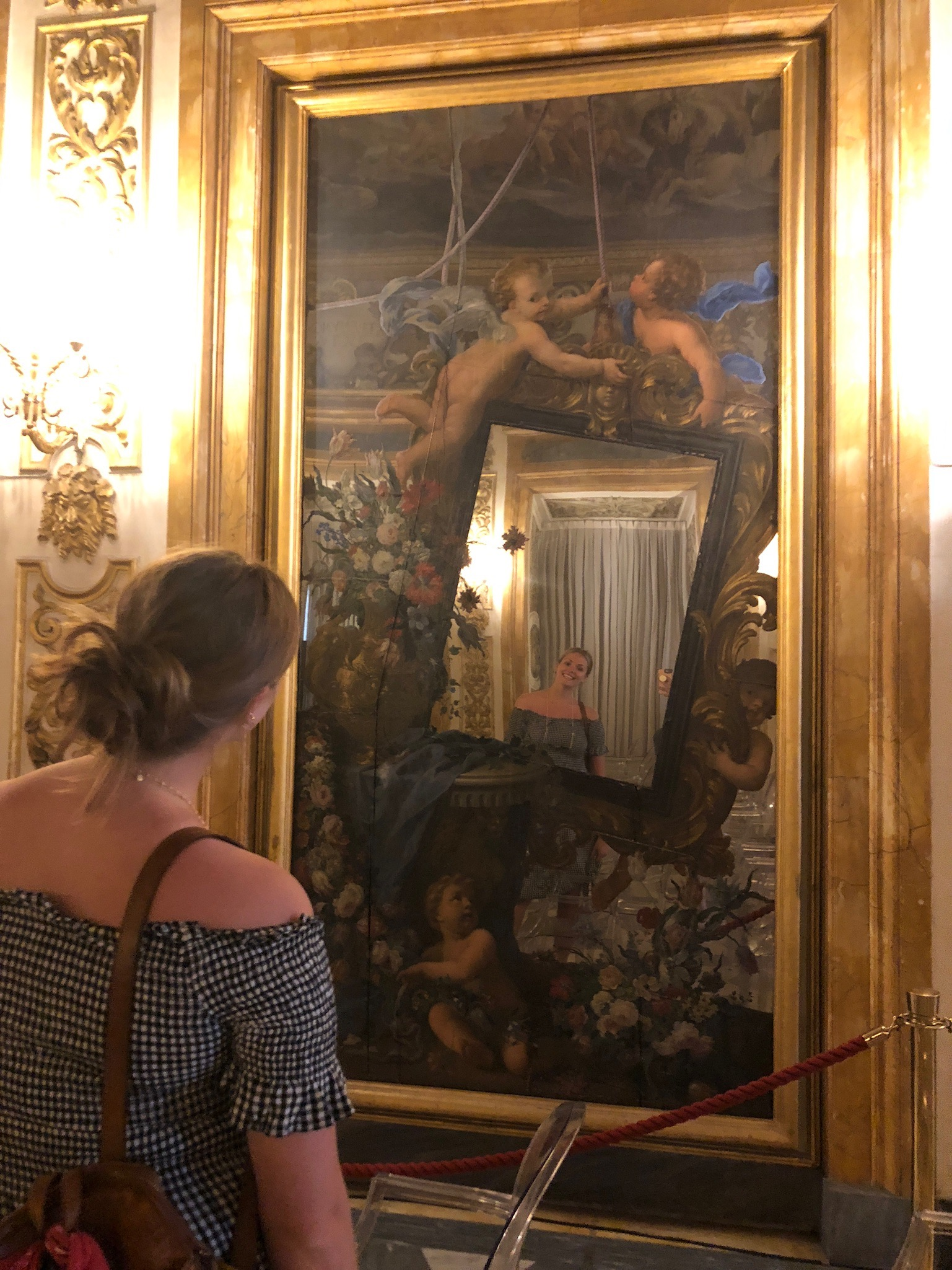 Richly painted mirrors in the ballroom of the Medici home.