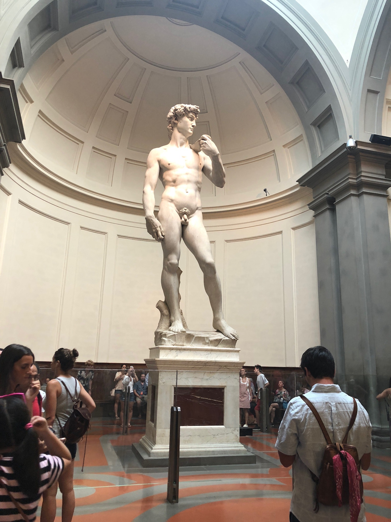 Michelangelo's David statue is made of marble and rests in the Accademia Gallery. Circa 1504, it is touted by some as the greatest masterpiece ever created by mankind. Michelangelo painted the ceiling of the Sistine Chapel years after sculpting The David.