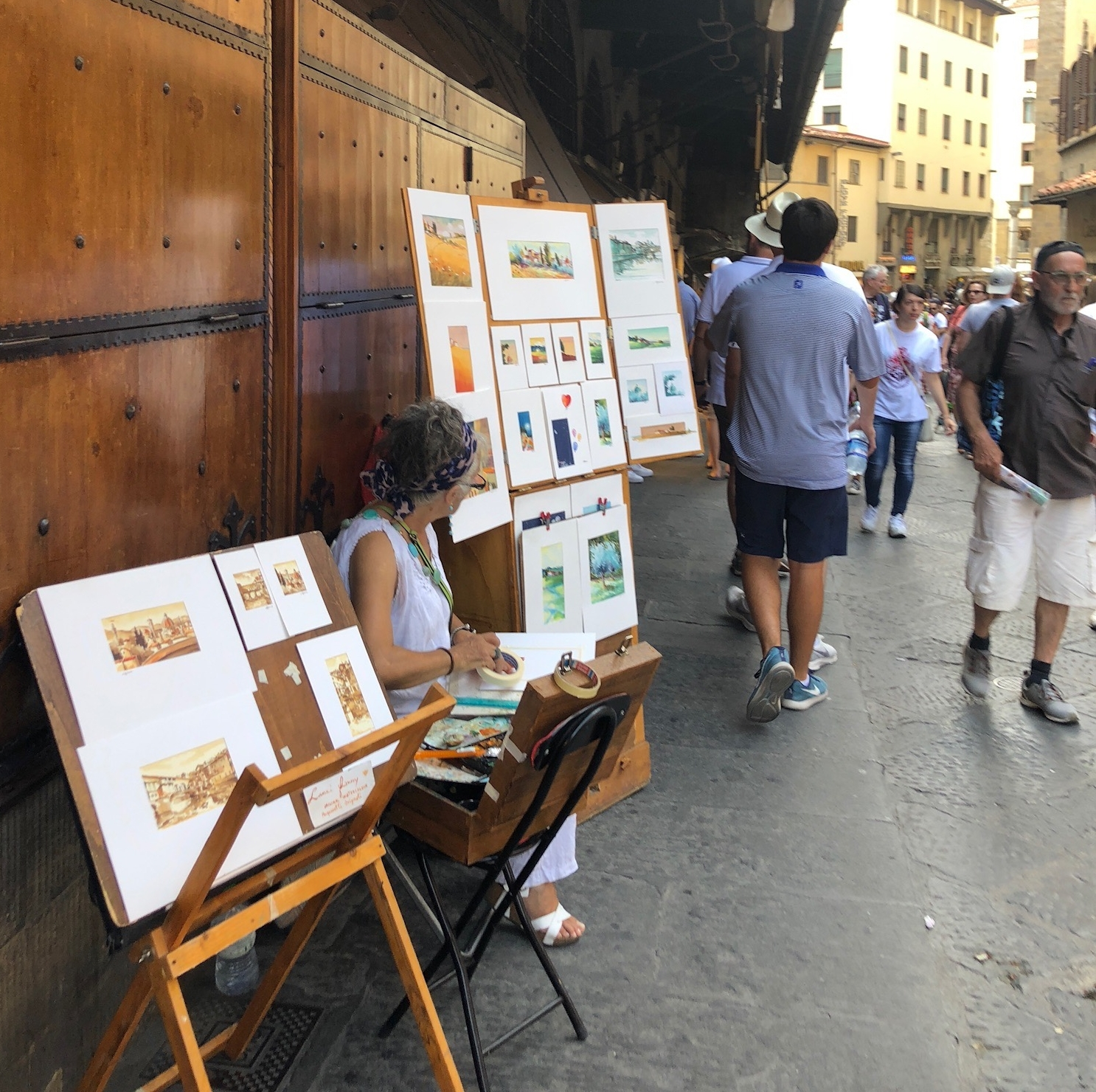 A painter displayed her works that are stowed in these wooden cabinets outside in the artisan district.