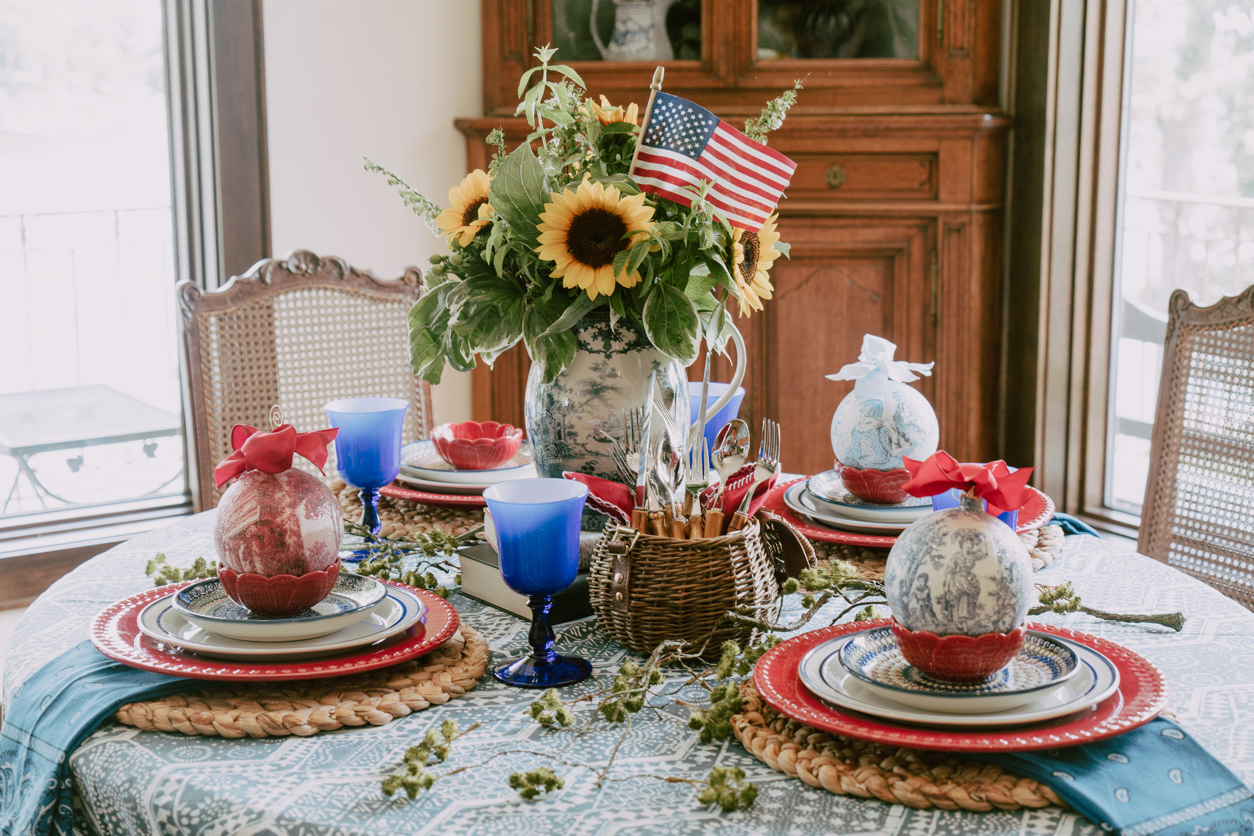 The blue toile pitcher from Nell Hills is the perfect centerpiece with sunflowers for the 4th. Flowers by The Little Flower Shop.