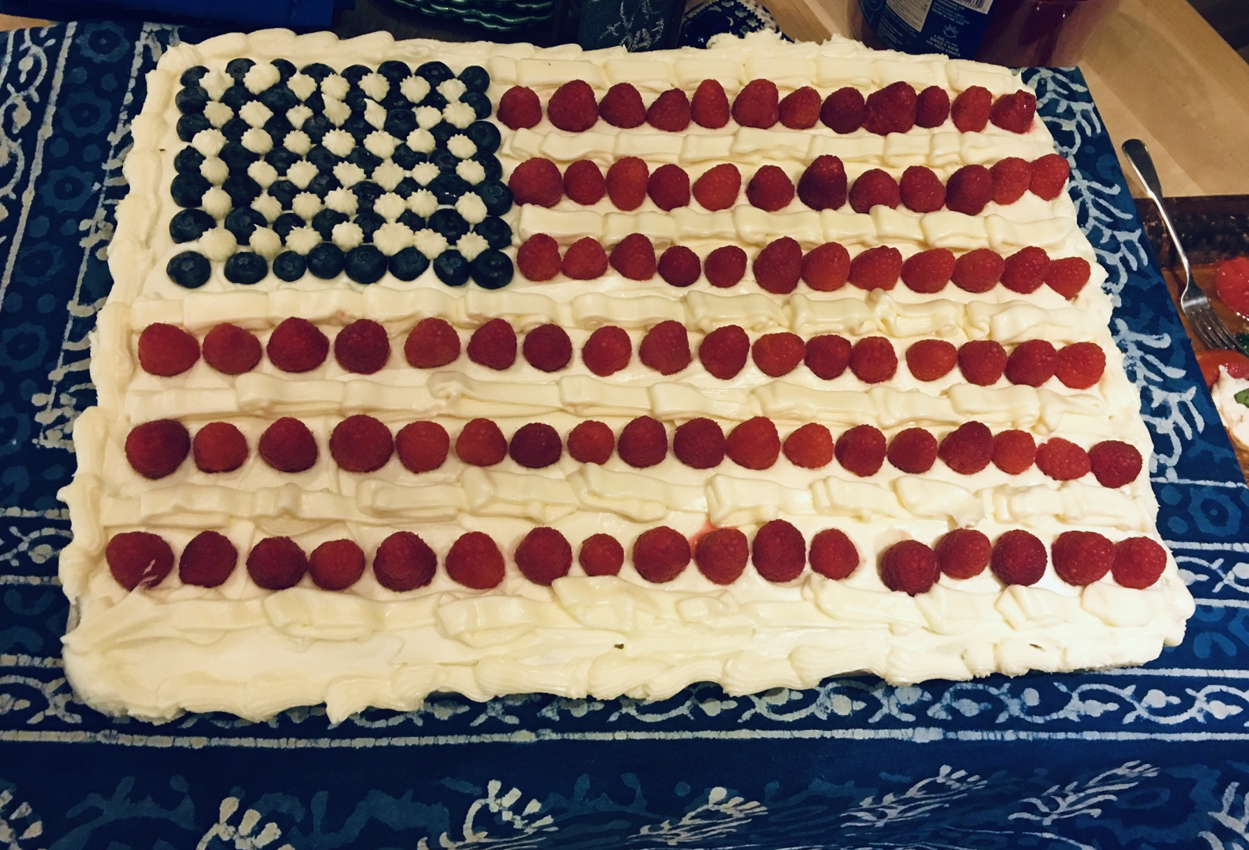 "Three cheers for Ina Garten! She has created a tradition for our family that I believe will never fade. ""Flag Cake."" This is my cake from two years ago. I will be making this year's on the 3rd of July and icing it on the 4th."