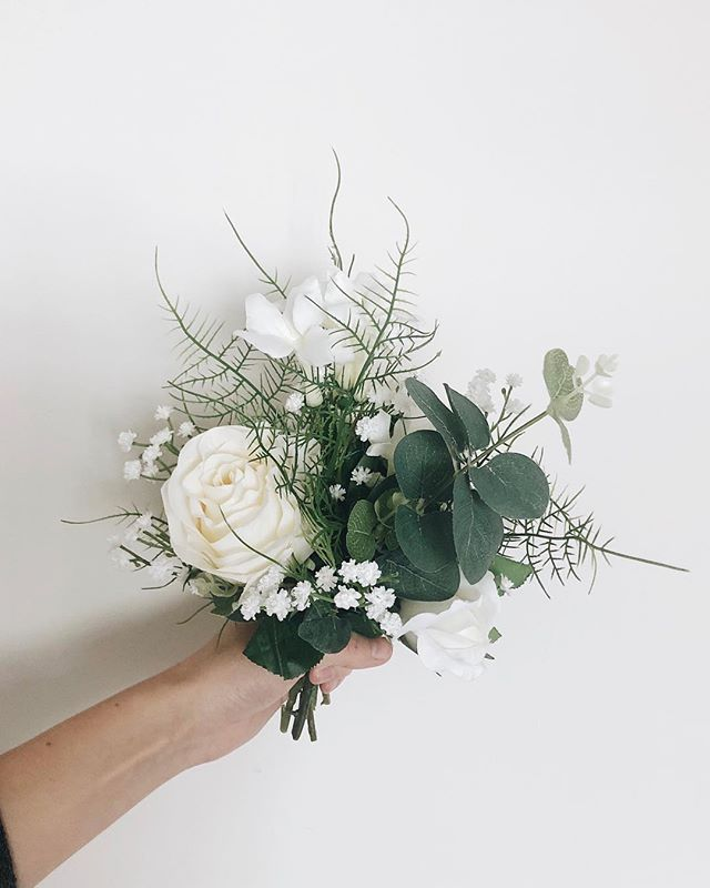 I've been experimenting with making my own wedding bouquets using silk flowers. Real ones were way too expensive! Thoughts?