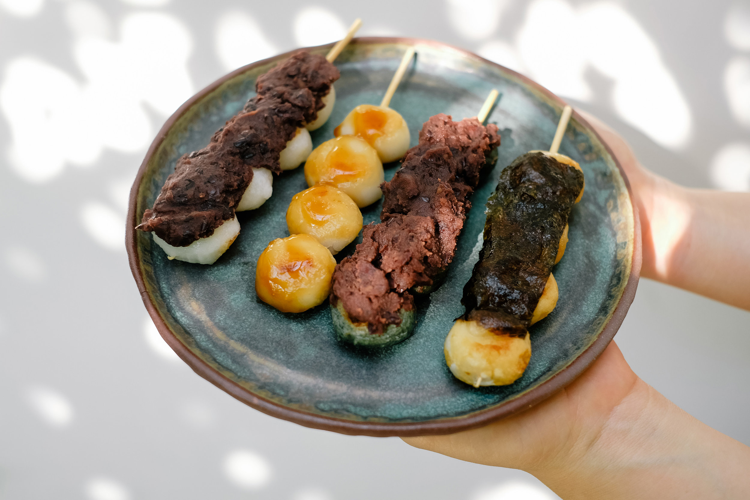 Anko (an) dango:  Red bean paste with mochi   Mitarashi dango:  Grilled mochi ball covered in a caramelized sweet soy sauce   Kusa dango (Yomogi dango):  Green spring dango made with Japanese mugwort (yomogi), sugar and red bean paste   Isobe Dango:  Mochi wrapped in seaweed