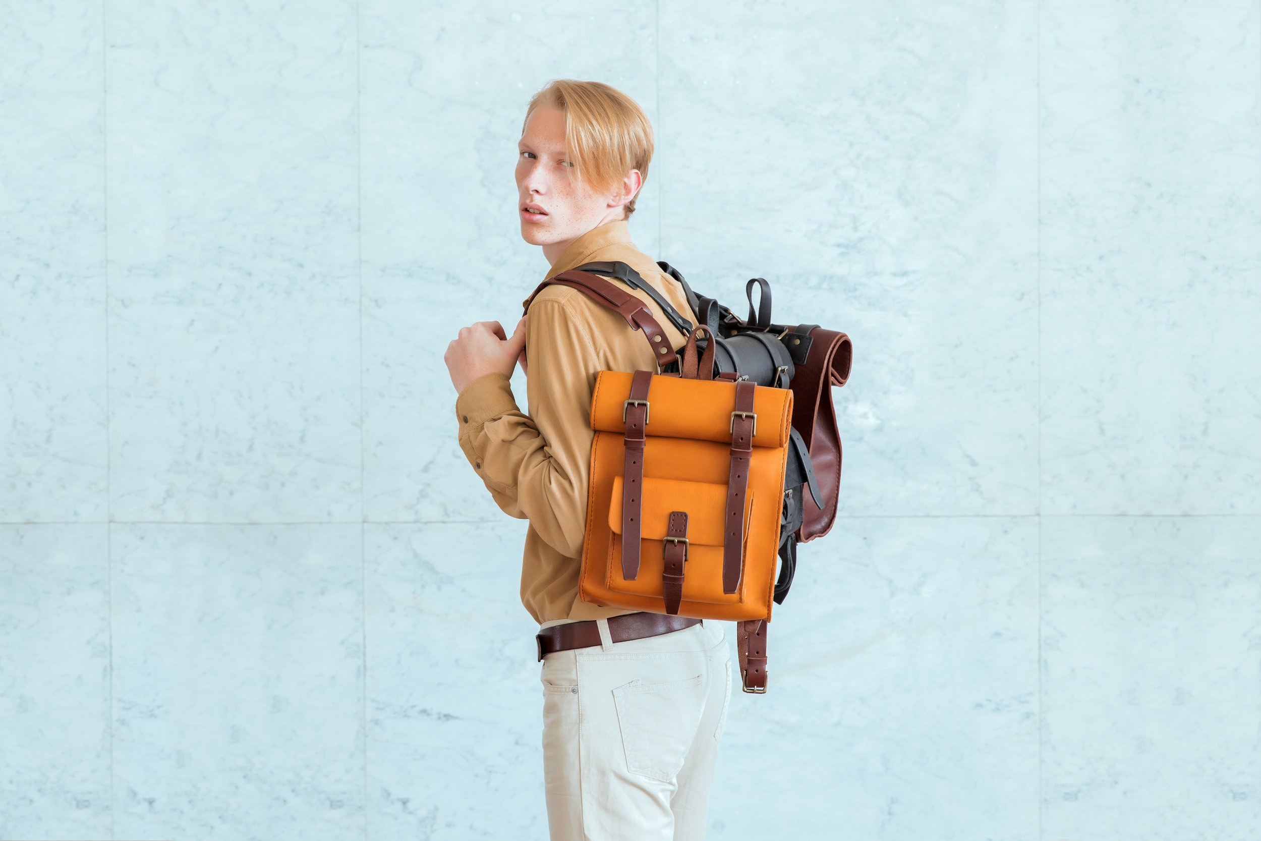 Maria Svarbova photography of man with luxury leather rucksacks