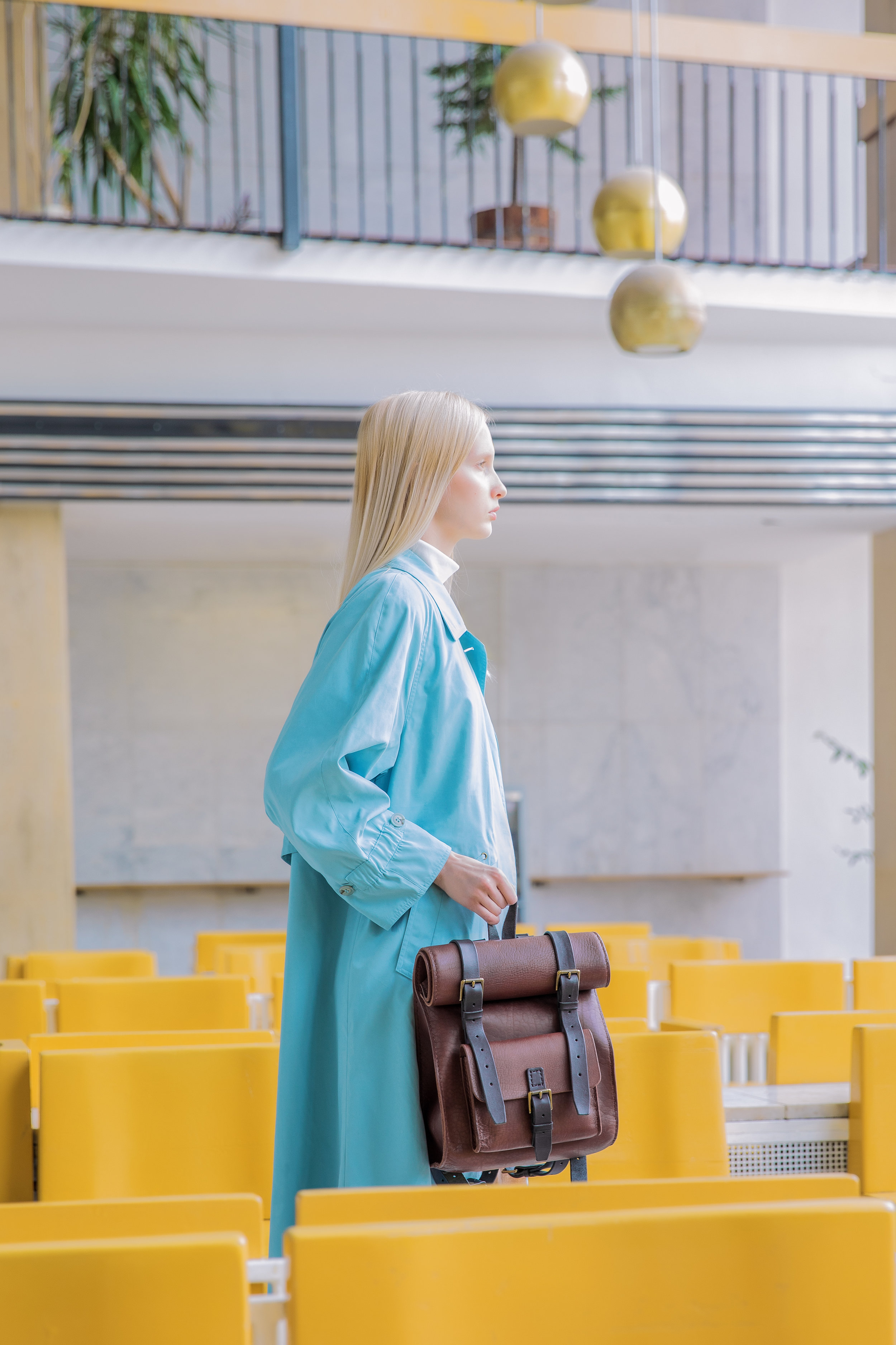 Blond model with handmade roll top rucksack