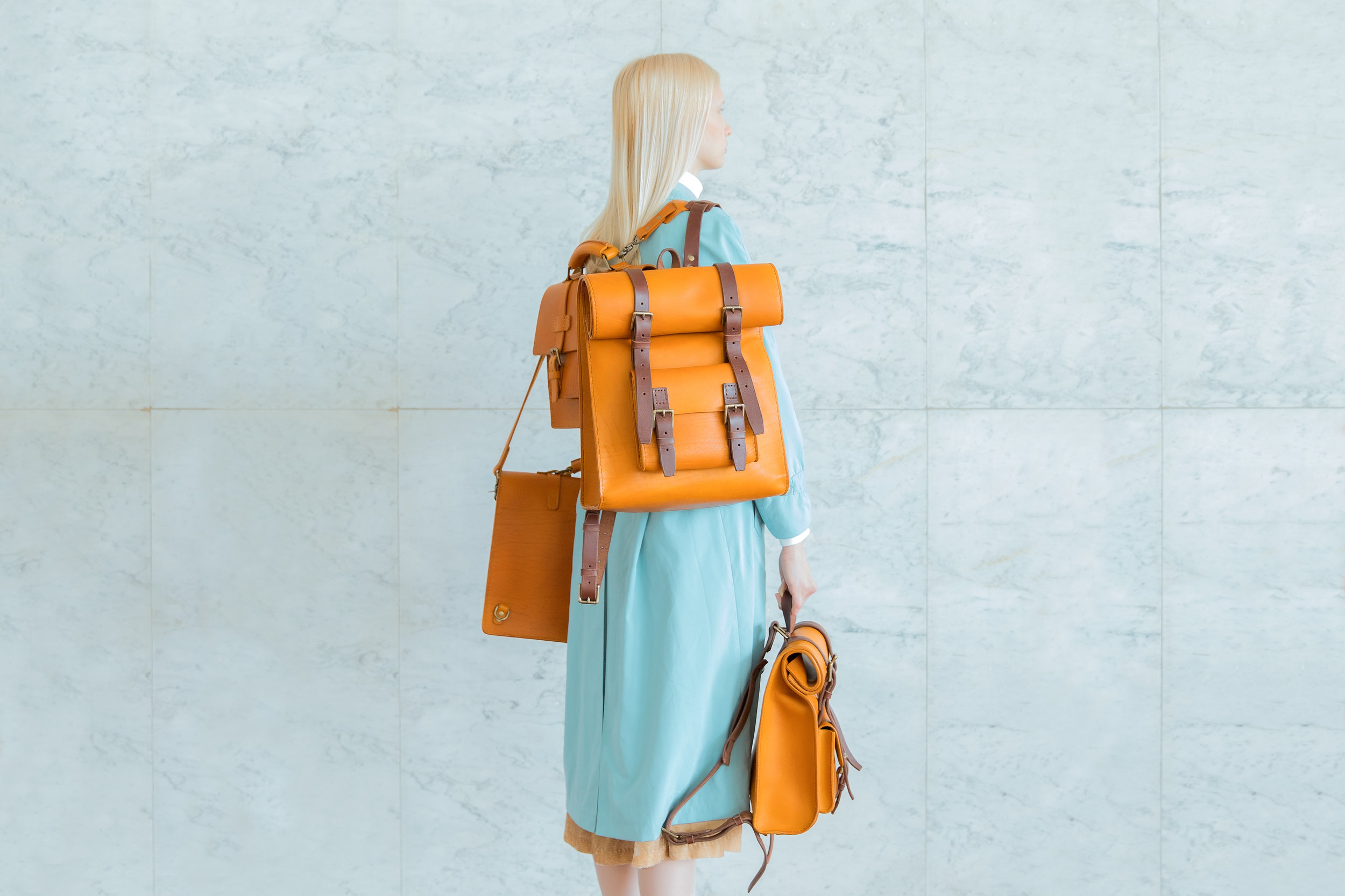 Mária Švarbová photo of model with saddle stitched bags