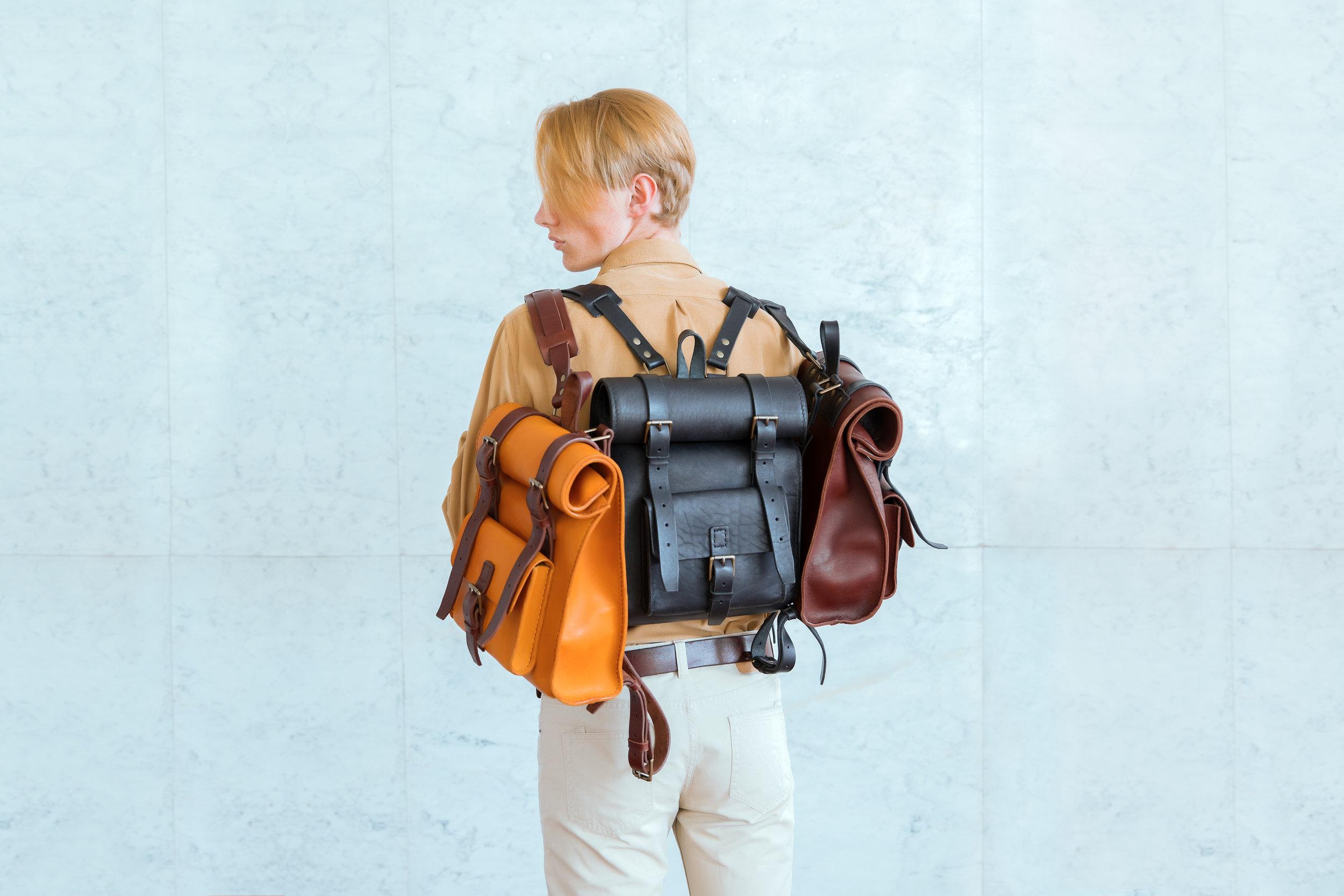 Boy with three handmade rucksacks