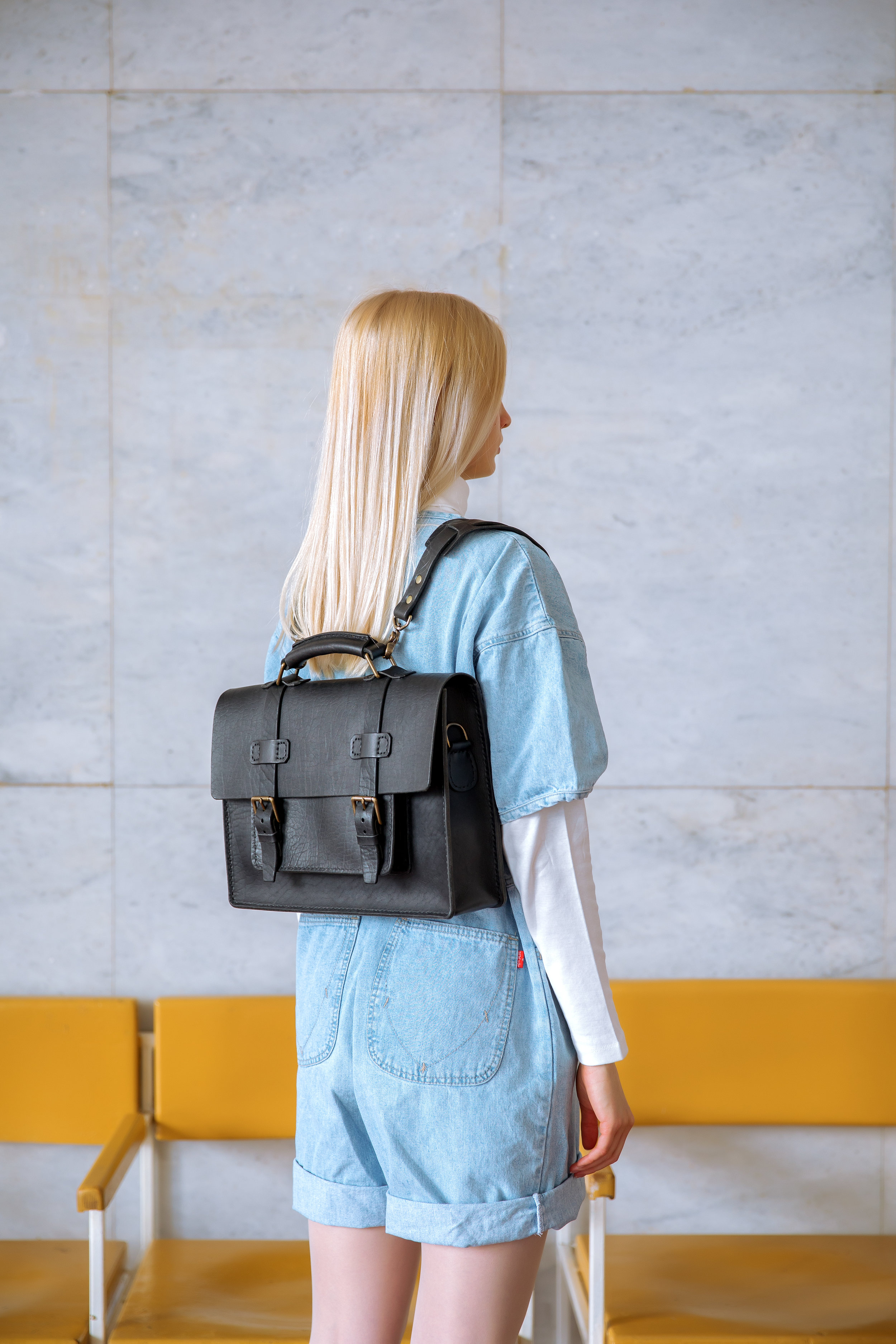 Handmade leather briefcase on blond model