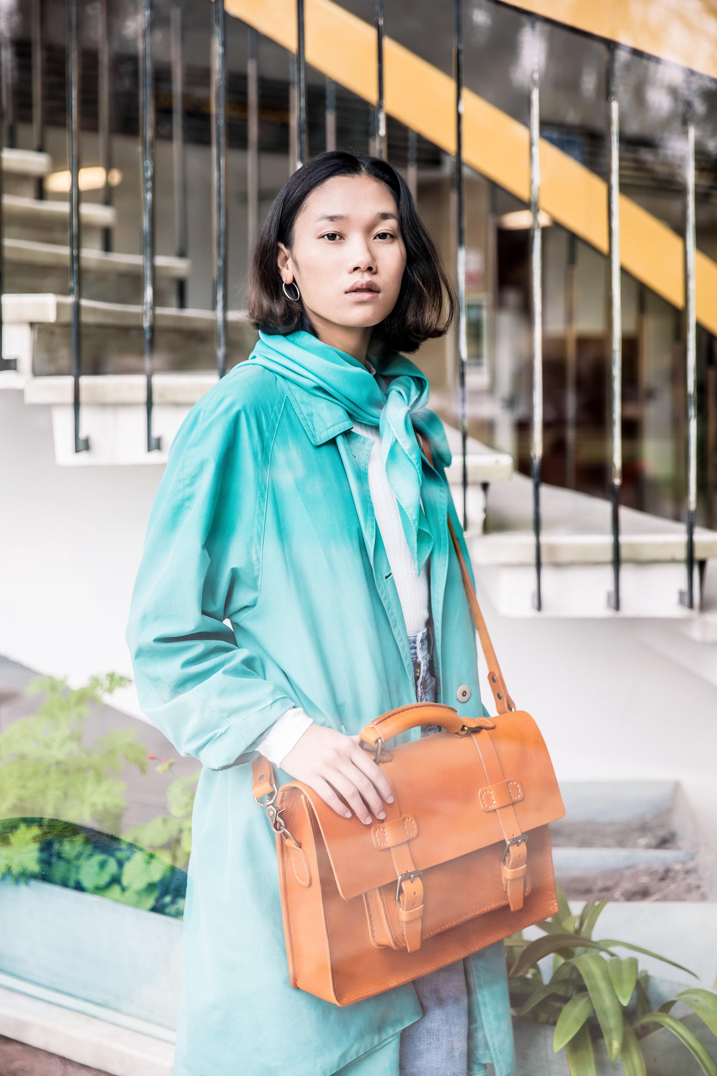 Vegetable tanned handmade messenger bag on model
