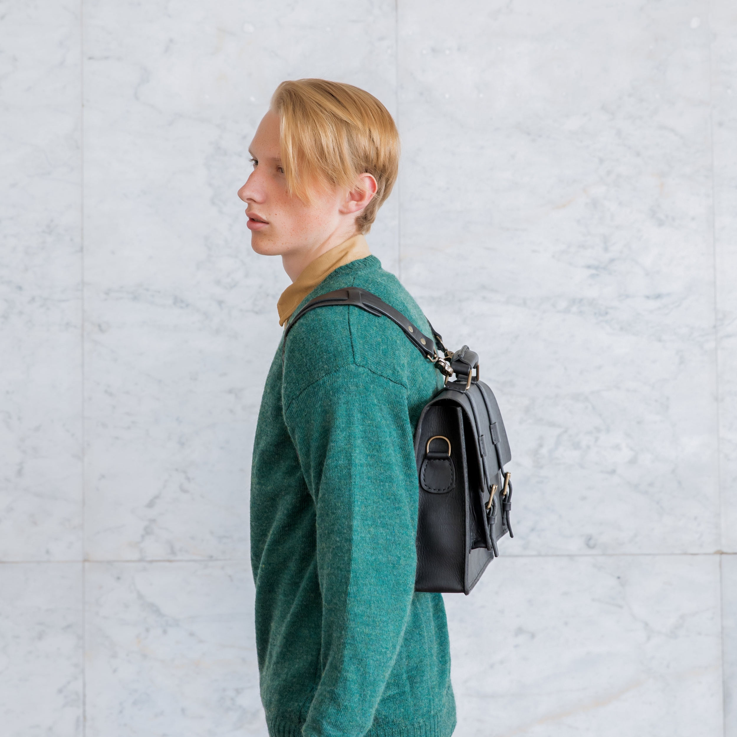man with saddle stitched briefcase worn as backpack