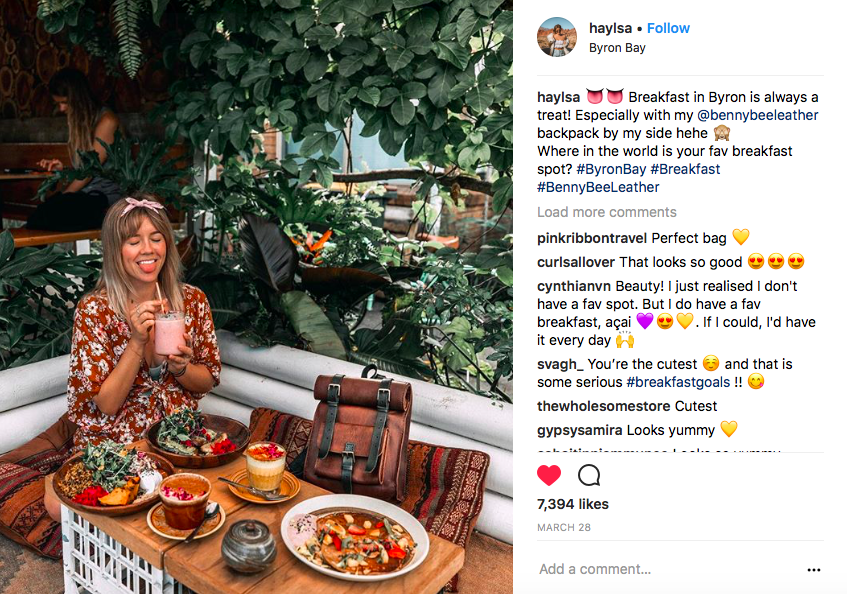 Instagram creator in Byron Bay with handmade leather backpack
