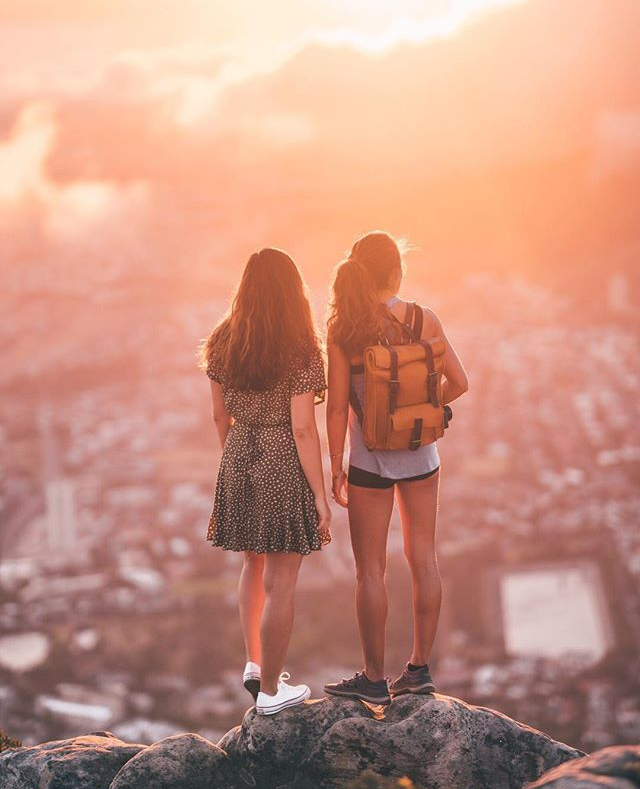 Raya Was Here and Chealsea Kauai on Lions Head in Cape Town with bennybeeleather handmade vegetable tanned full grain leather roll top vintage style backpack