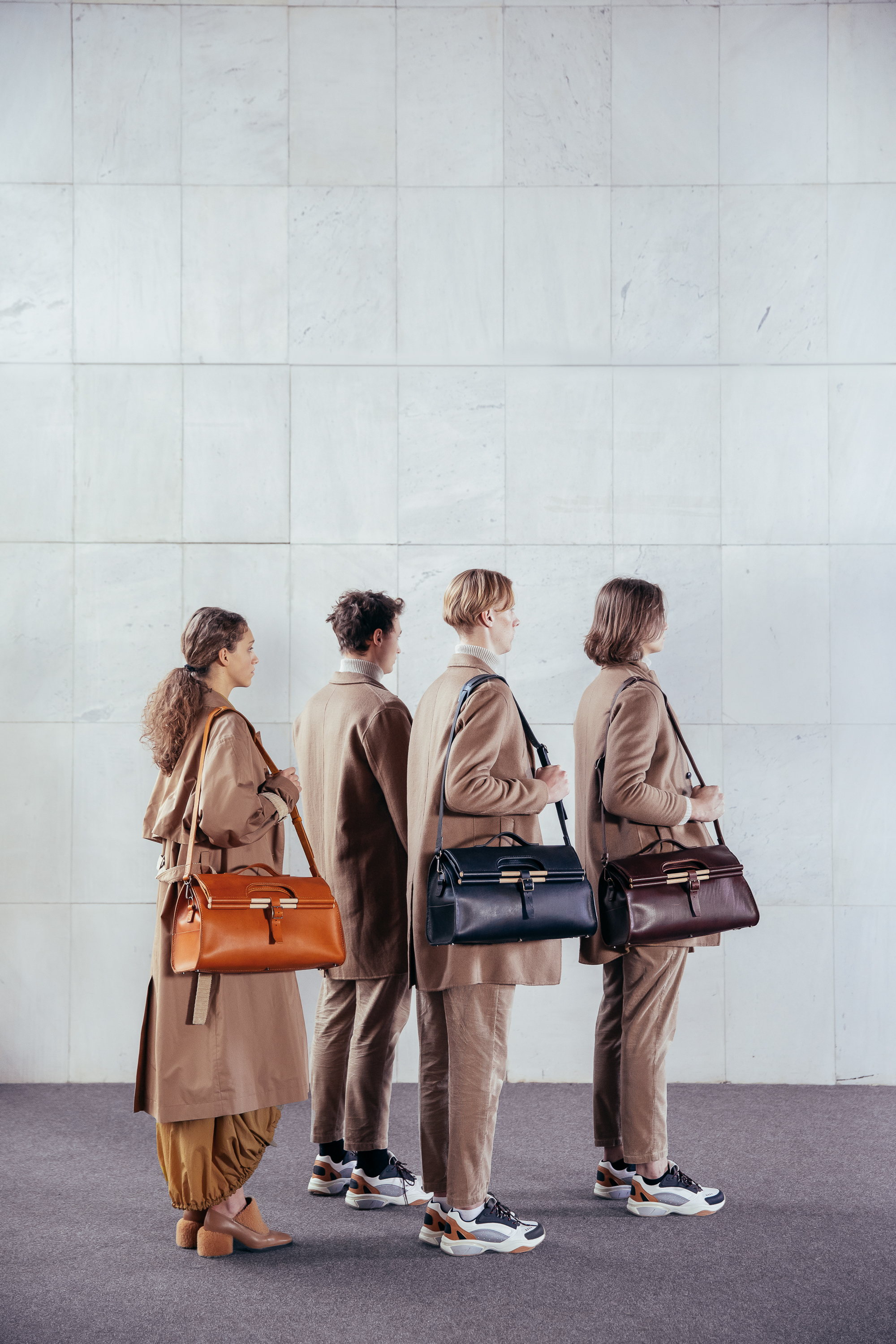 Weekender Tote Bags made entirely by hand, in vegetable tanned full grain leather, saddle stitched, pictured on men and women