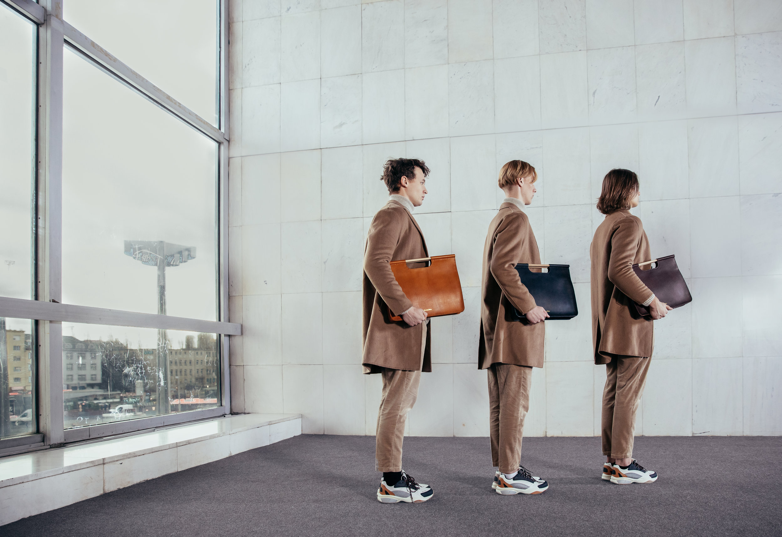 Handmade vegetable tanned leather attache work bags in cognac, chestnut, and black