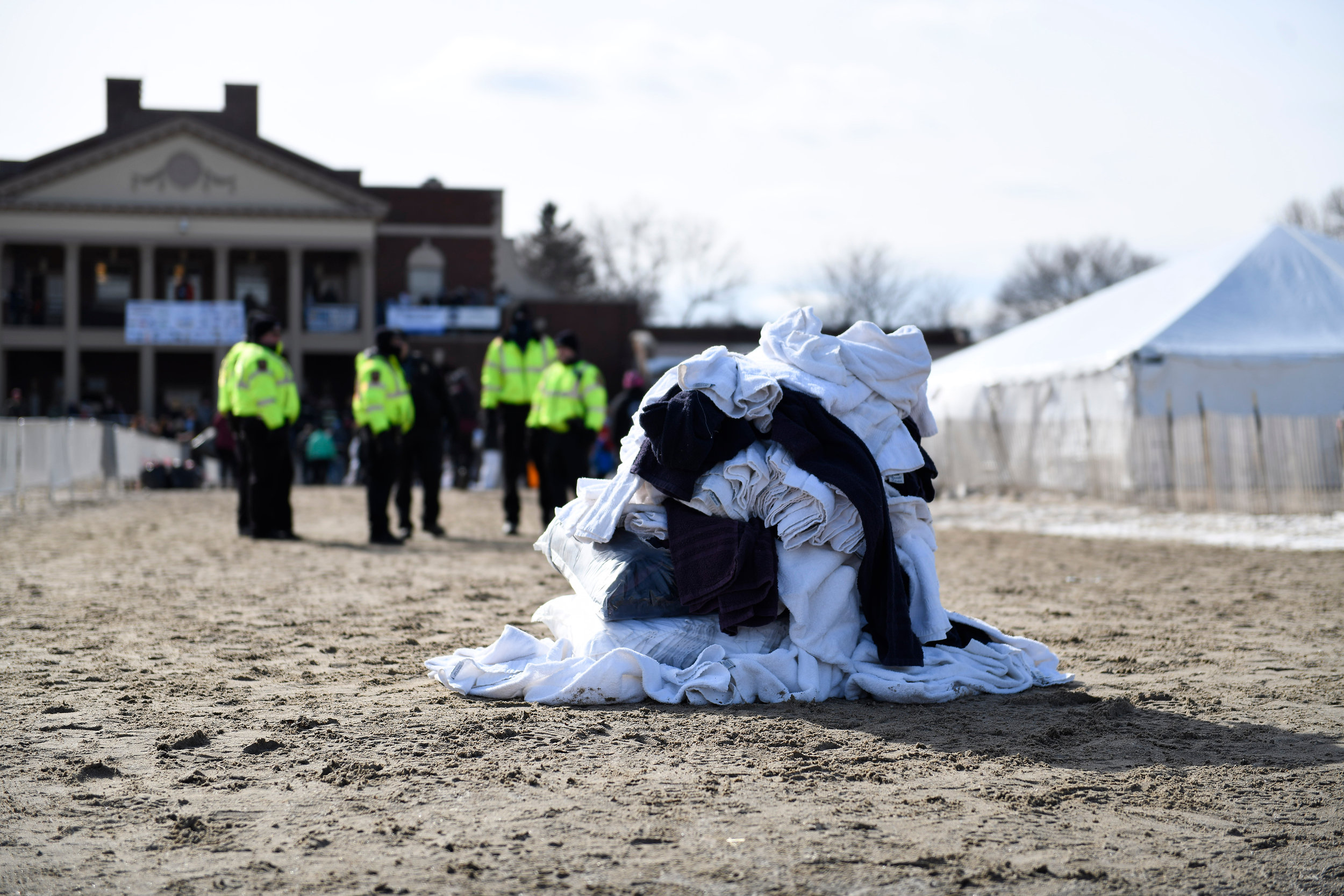 A pile of used towels lays on the beach after the 2019 Polar Plunge in Rochester, N.Y. on Feb. 10, 2019. The 2019 Polar Plunge raised over $250,000 for the Special Olympic community.