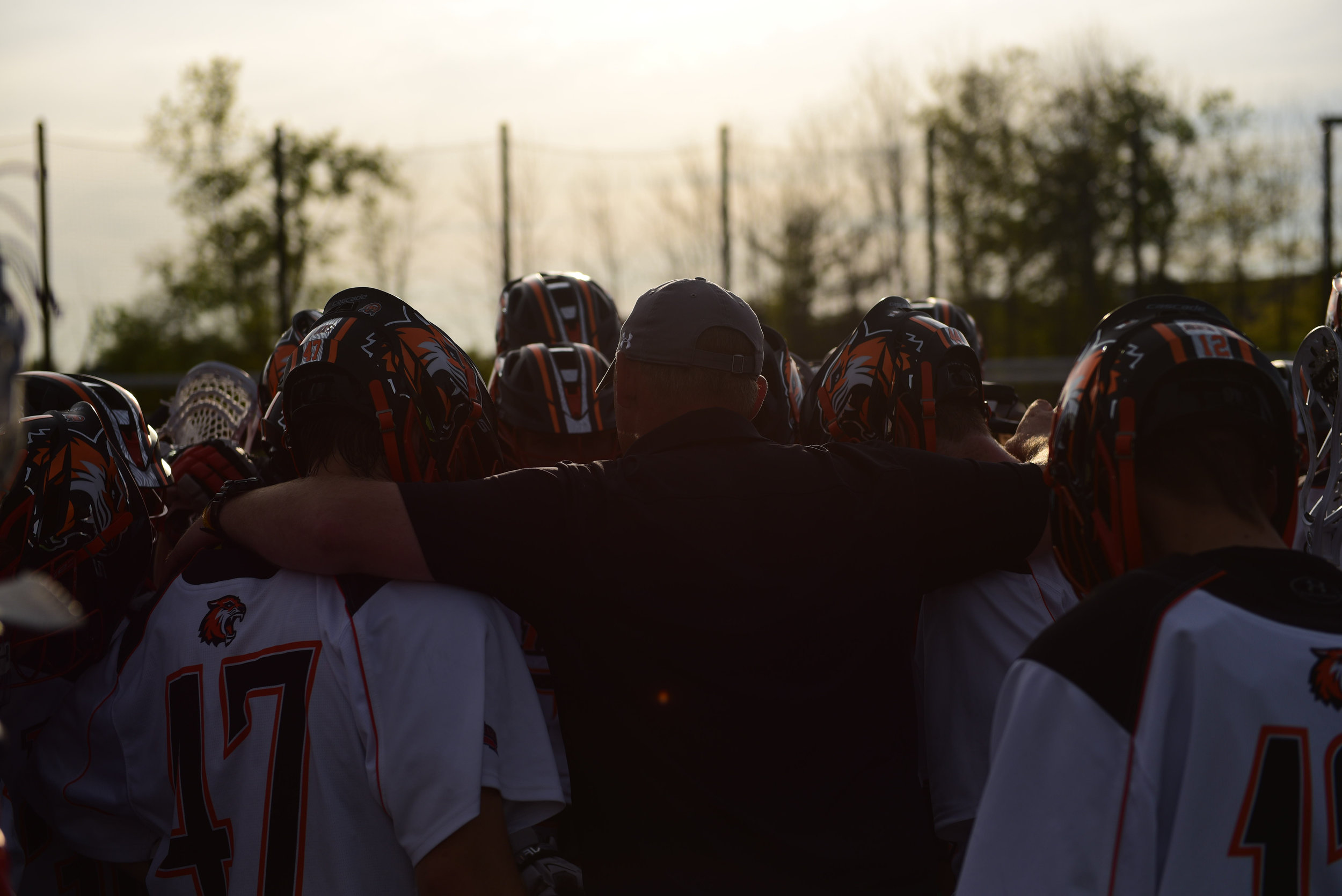 The RIT Tigers huddle before their game against York College in the Quarterfinal Round of the NCAA Men's Lacrosse Championships at the RIT Turf Field in Henrietta, N.Y. on May 16, 2018.
