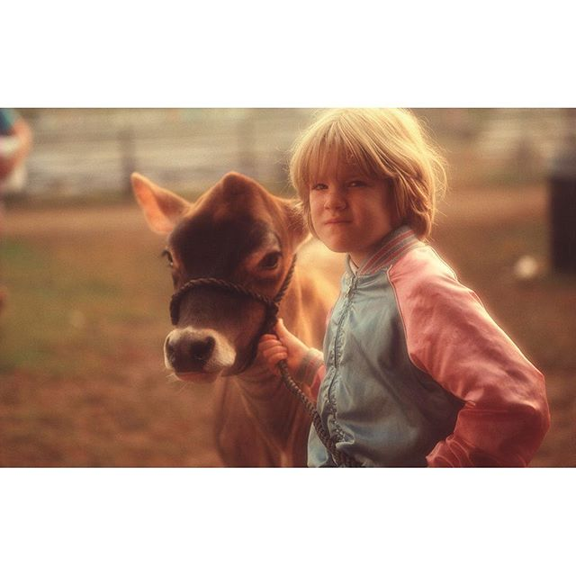 Digging into the archives and found this girl. Just another day on the farm. . . . . #tbt #animalfarm #kidsandanimals #cowsofinstagram #cows #moo #afternoonglow #goldenhour #vintagelighting #vintagephoto #farmlife #farmanimals #glowing #farmersofinstagram #oldphotos #throwbackthursday #farmingfamily #farming #babycow