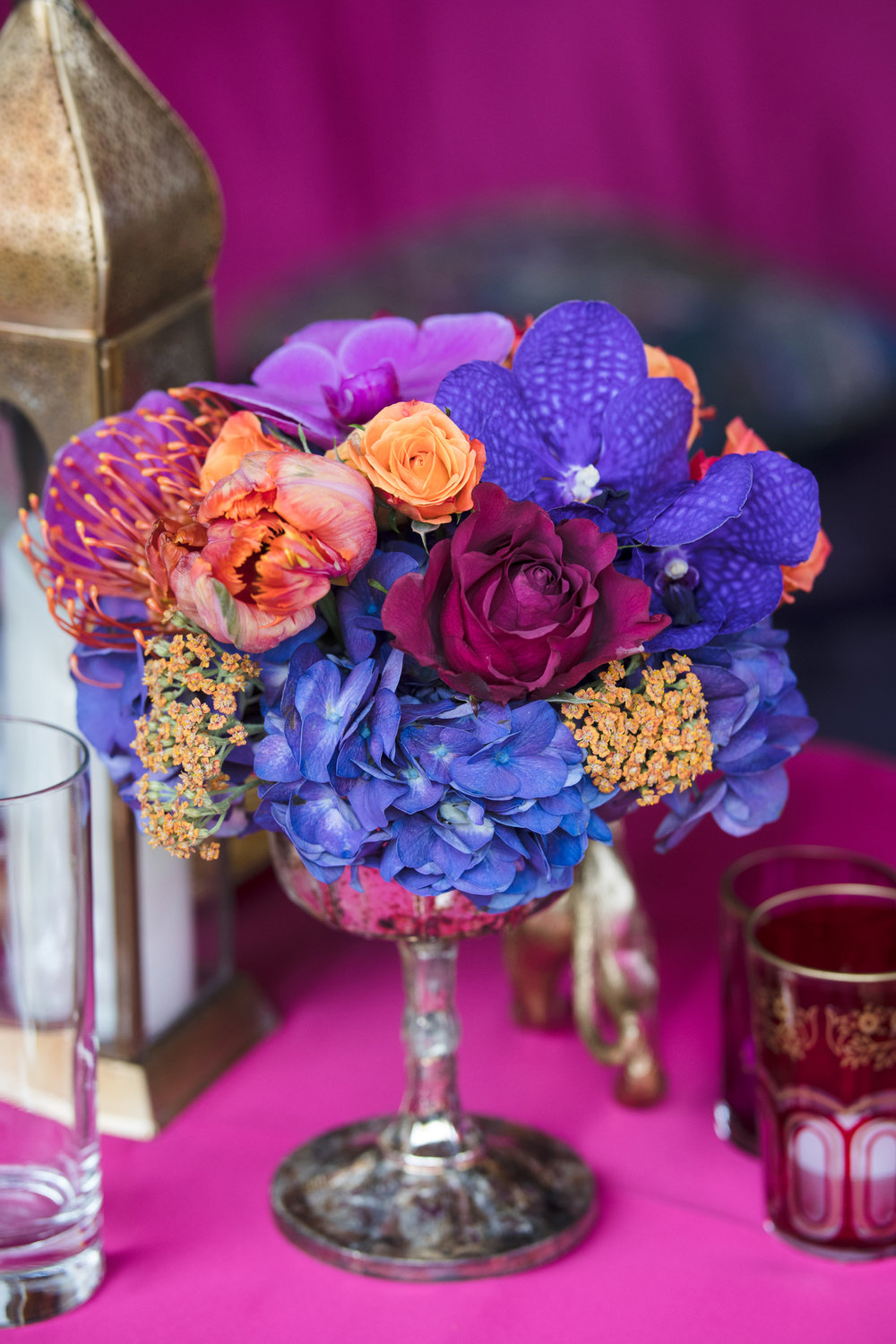 Moroccan+Inspired+Baby+Shower+Party+rich+colorful+florals+on+the+table