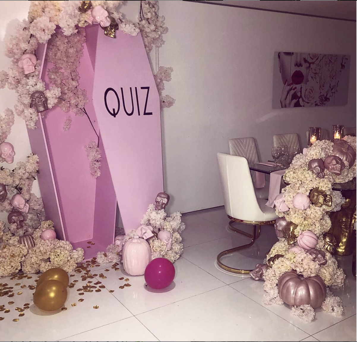 Think Pink - Don't assume that just because it's Halloween you have to stick with the traditional color palette! We custom created this pink coffin for this Quiz Queen dinner.
