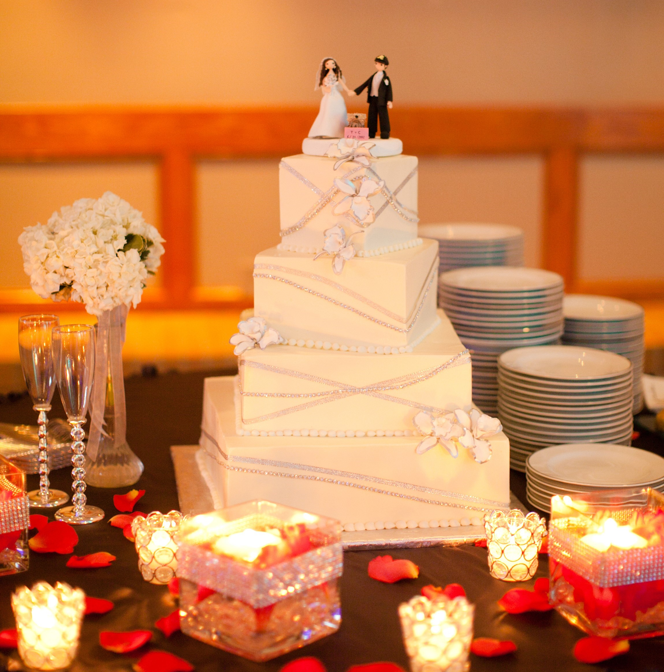 Wedding Cake on Table Decorated with Candles and Flowers at Cherry Hill Ballroom