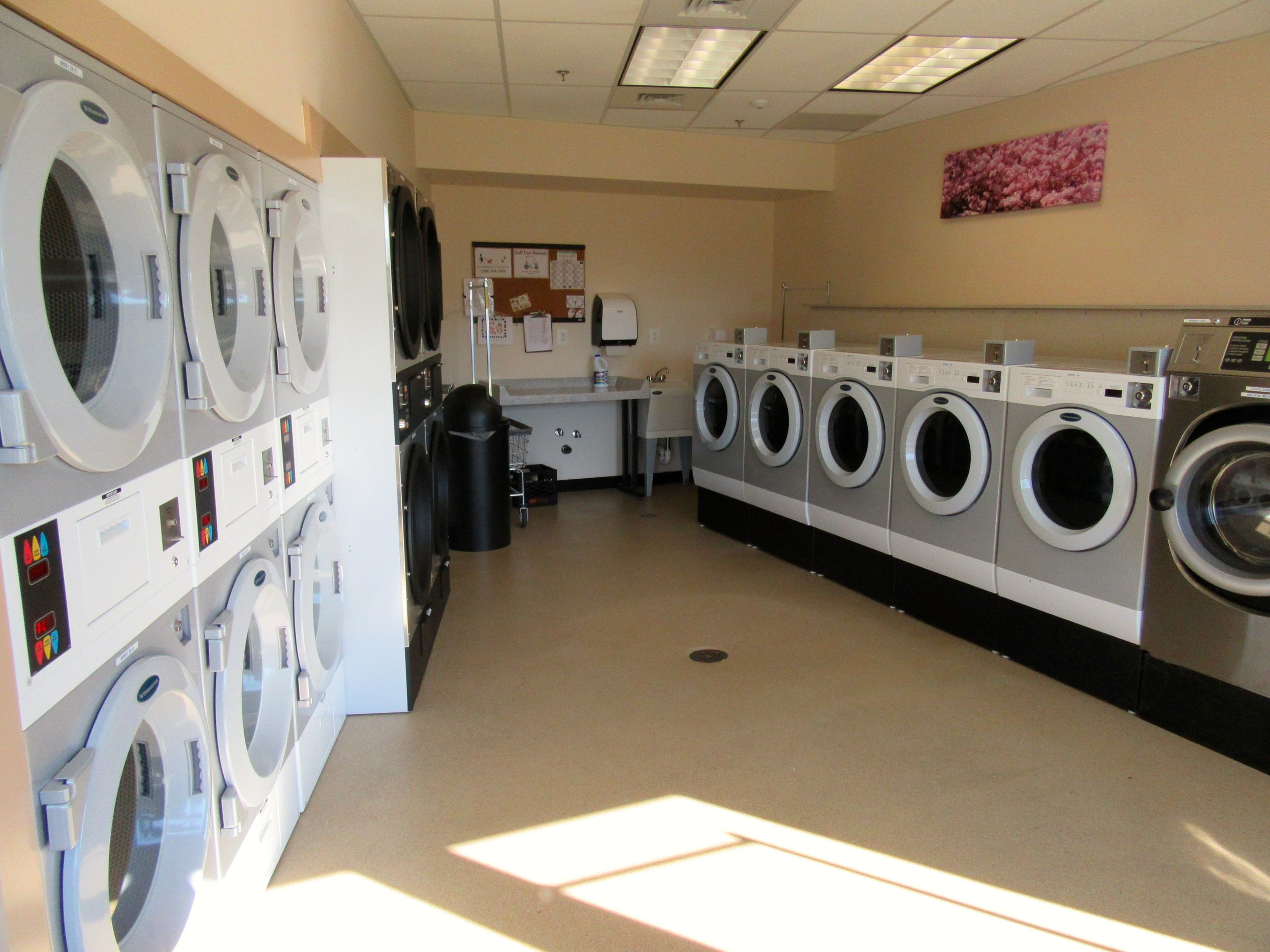 Rows of Washers and Dryers in Cherry Hill Park's Laundry Room