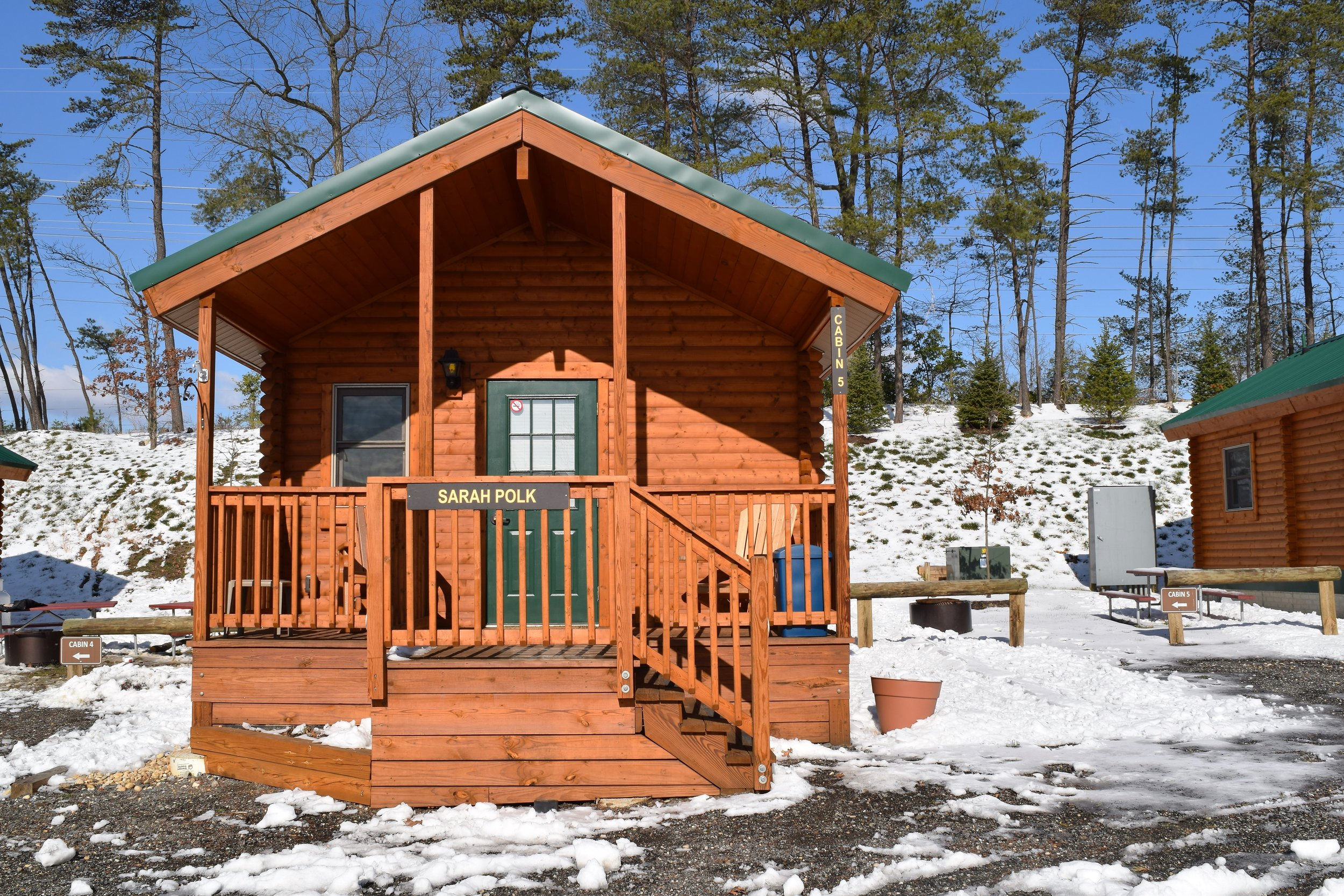 Premium Log Cabin Front View in Winter Snow