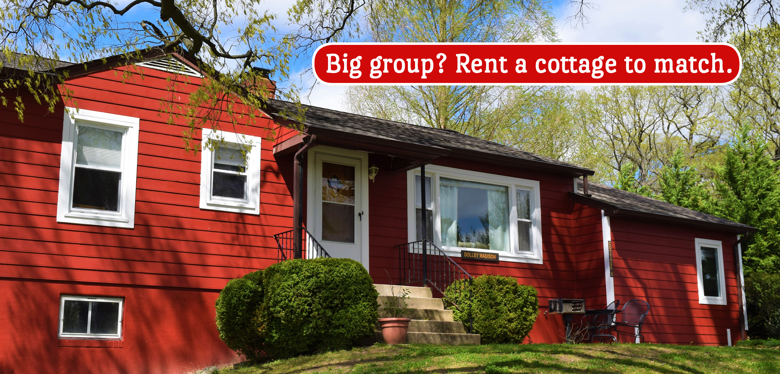 Big group? Rent a cottage to match. Red house with white trim.