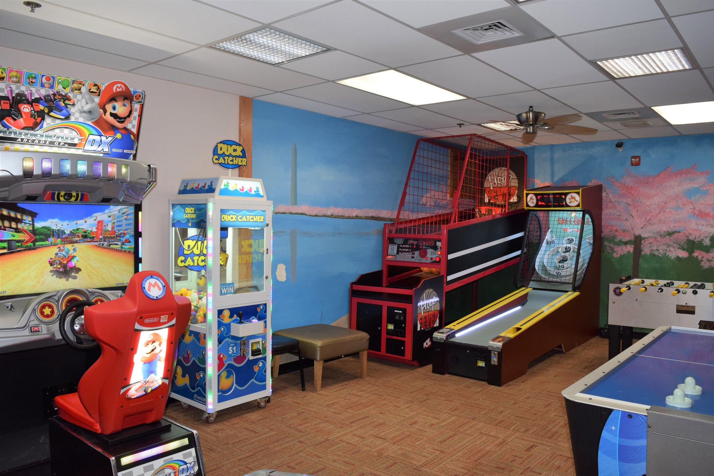 A row of arcade games at Cherry Hill Park