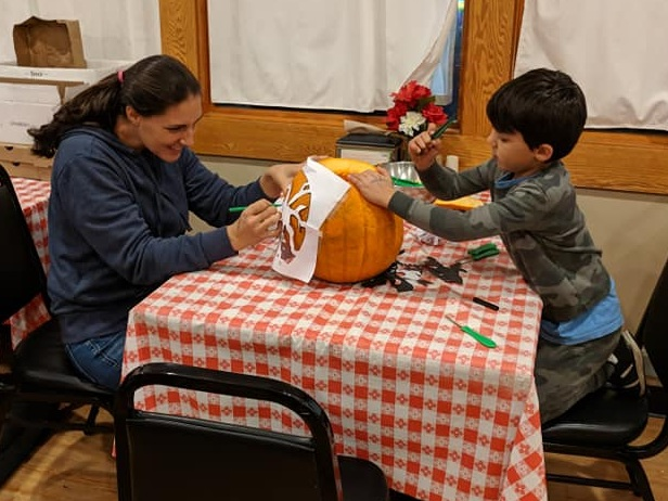Mother and Son Carving a Pumpkin at Cherry Hill Park's Halloween Weekend