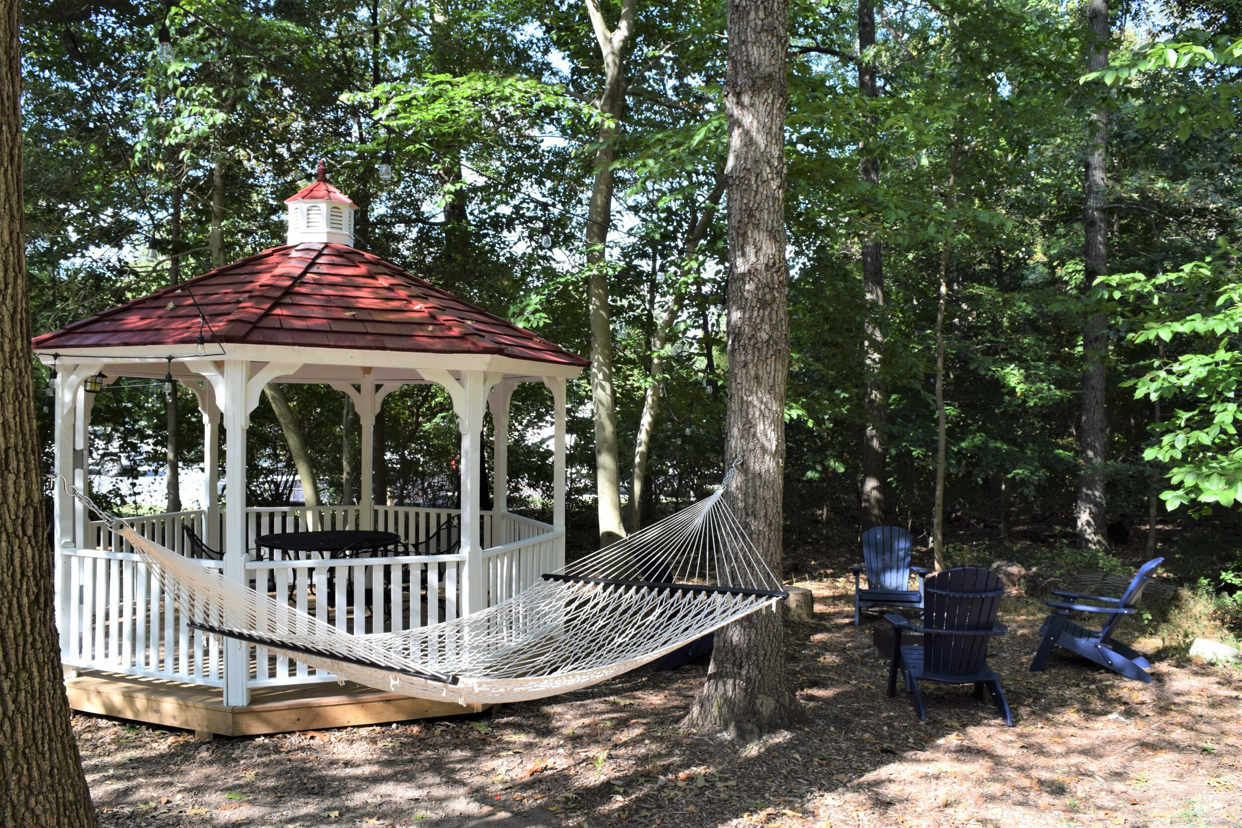 Premium tent site - hammock, gazebo, circle of Adirondack chairs