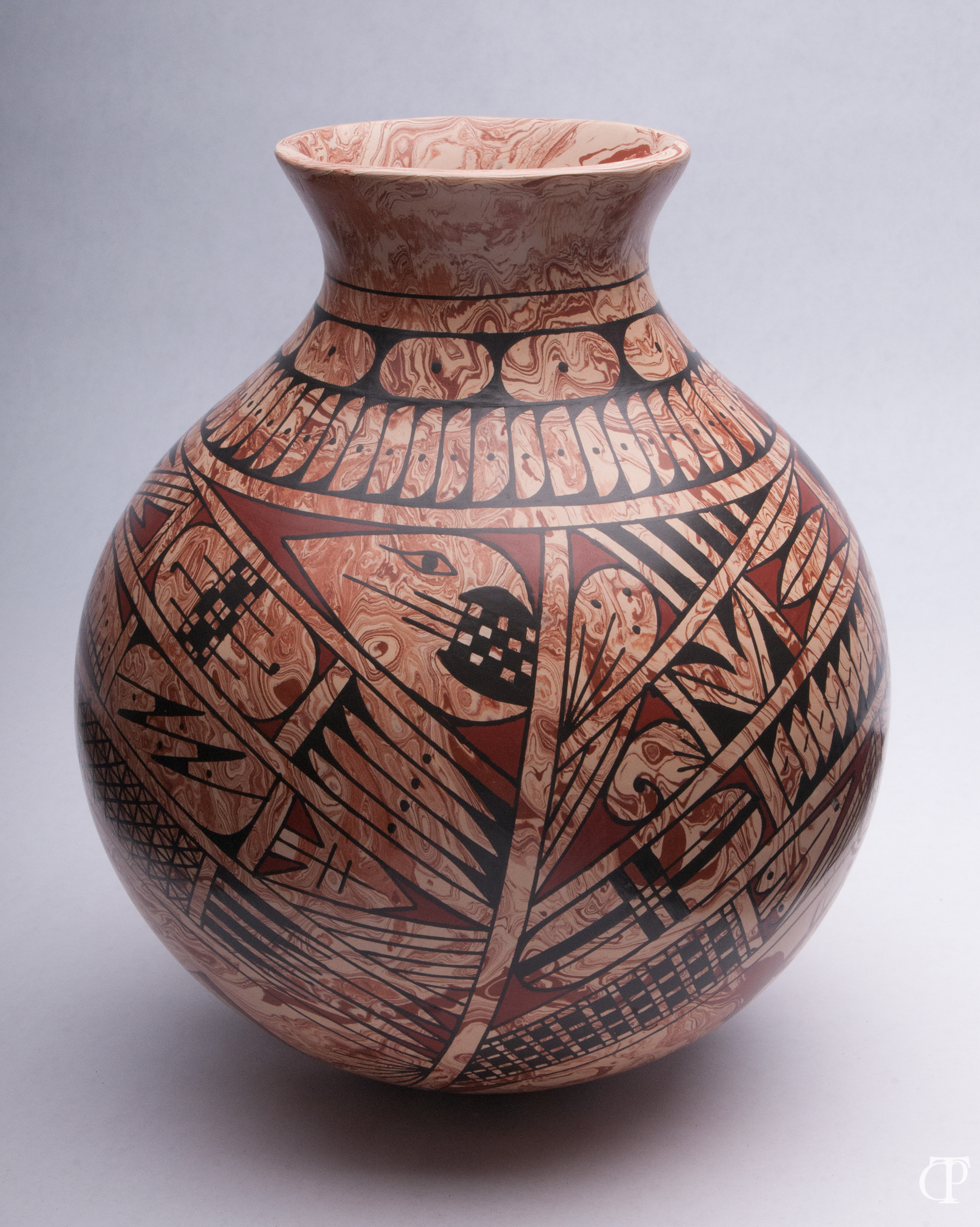 Ceramics - Photographing ceramics is more than just getting the basic shape and color. Good pottery has tactile features as well, and often an emotional sense, both of which must be conveyed in a photograph as well.