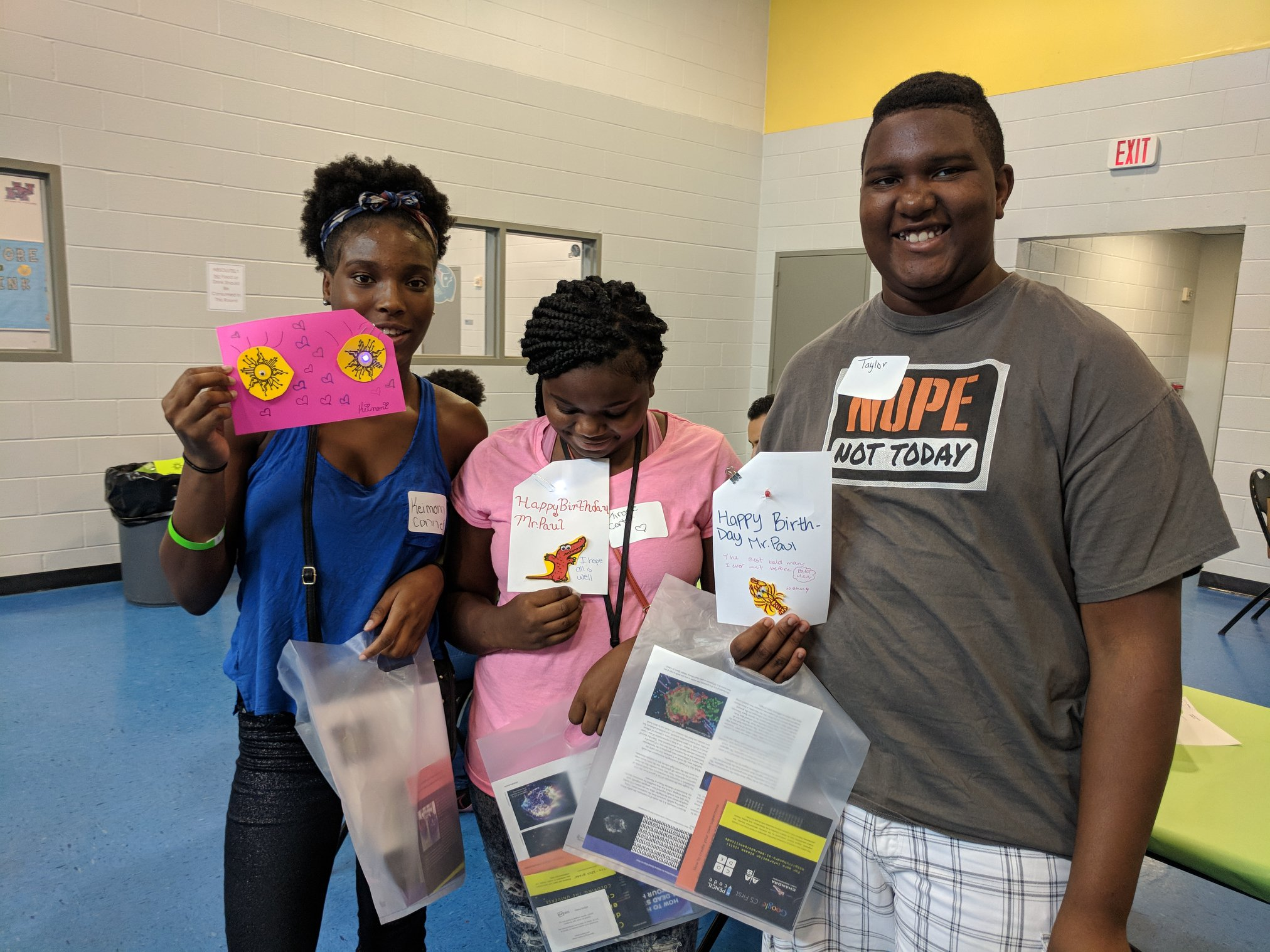 Students holding up the cards they made for Mr. Paul at the one day STEM Camp at Finnigan Park Community Center.July 7th 2018. Courtesy of Wanjun Zhang.