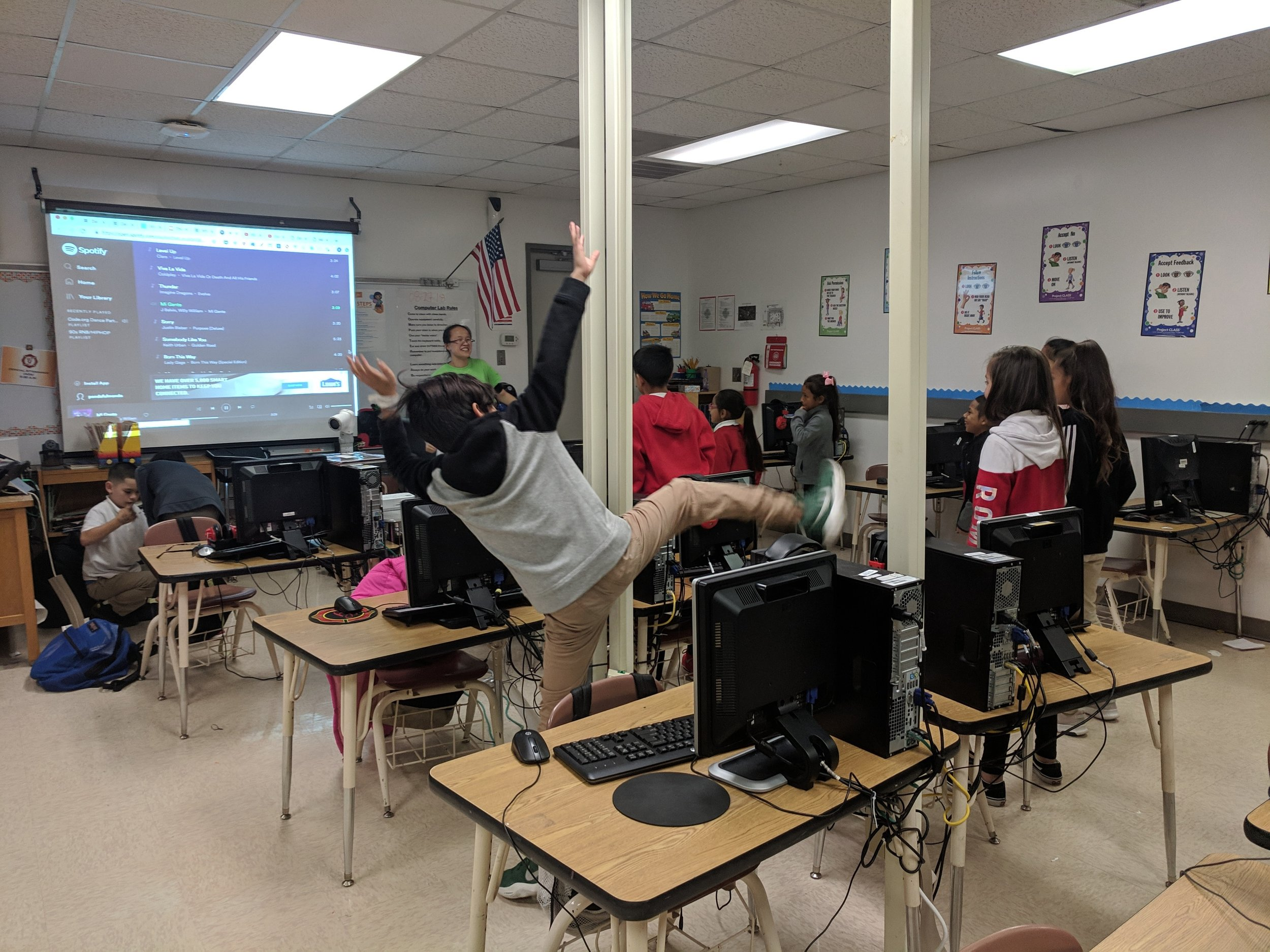 Students participated in the national CS Ed Tech week with Hour of Code Dance Party activity. They learned about events and coded characters in ways that surprised each other. Courtesy of Wanjun Zhang. December 4th, 2018.