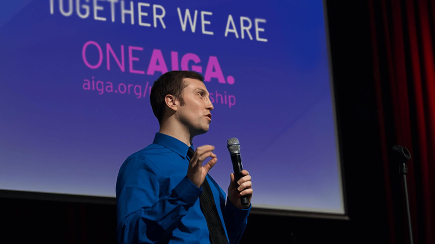 AIGA Boston President Matt Budelman delivering speech
