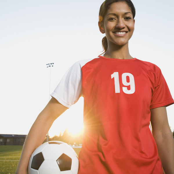 Active, healthy girl with soccer ball