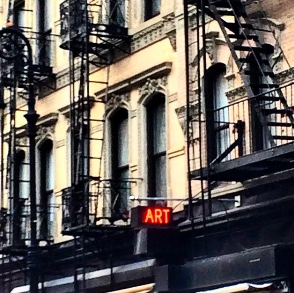 Art Sign Under Fire Escapes.jpg
