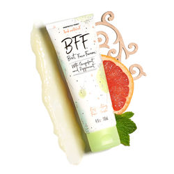 Posh BFF Exfoliating Face Wash with a grapefruit slice and mint leaves.