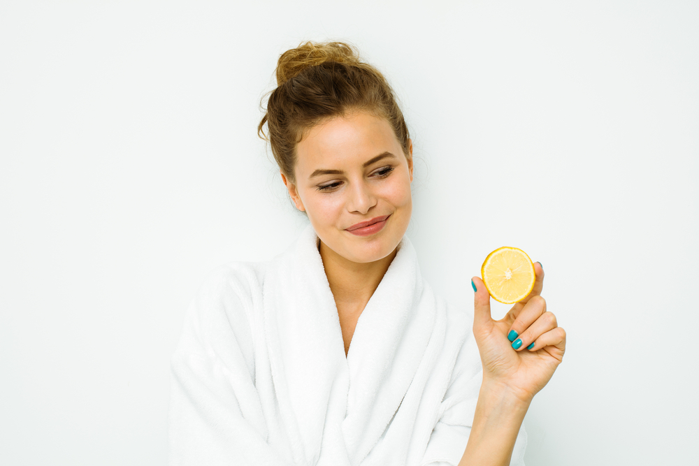 Woman holding lemon packed with vitamin C