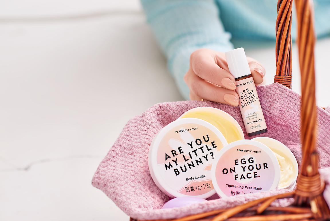 Perfectly Posh Basket Case Bundle stylized image with Are You My Little Bunny Body Soufflé, Egg on Your Face Tightening Face Mask with Poshbiotics, and Are You My Little Bunny Perfume Roller. Probiotic and prebiotic K-beauty Easter bundle