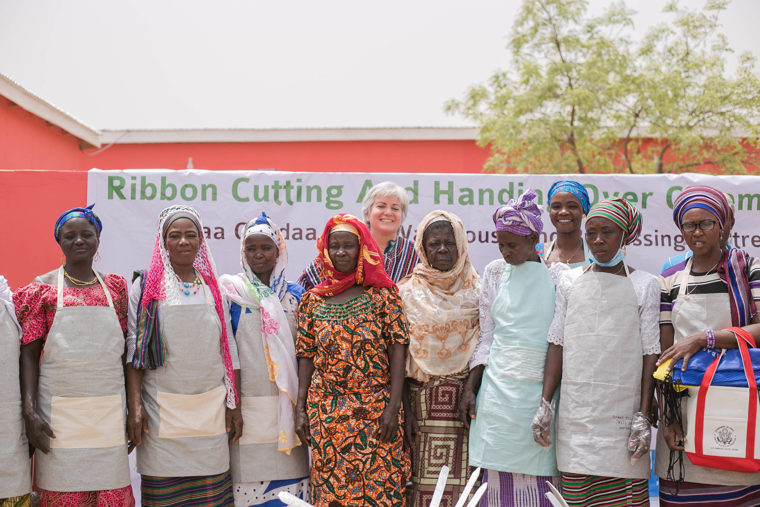Women in the Gizaa Gundaa community in Ghana at the Posh pink Shea Sisterhood warehouse ribbon cutting ceremony