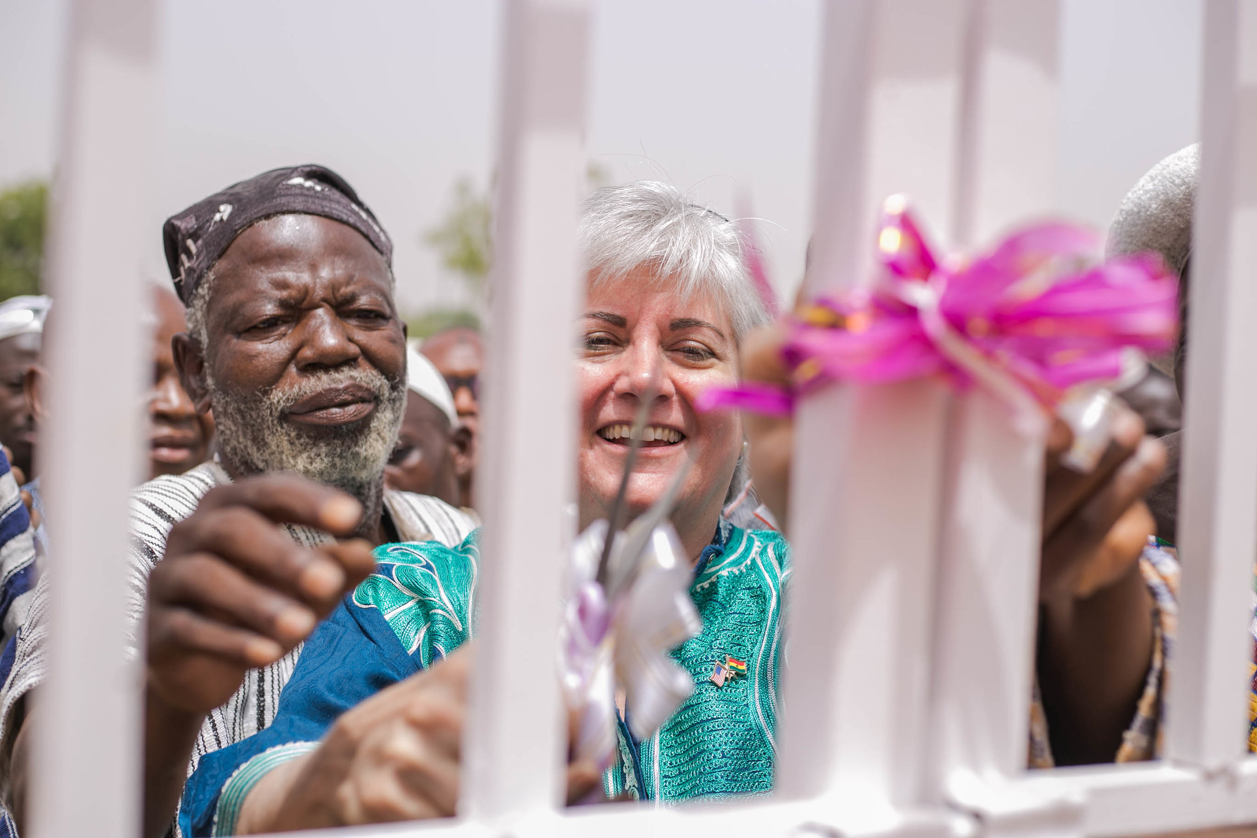 U.S Ambassador Stephanie Sullivan cutting the ribbon on the Shea Sisterhood warehouse and processing center in Gizaa Gundaa, Ghana.