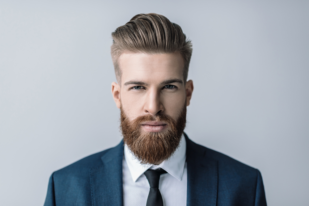 Bearded man in suit and tie, Perfectly Posh skin care routine for beards, men's products for beards and facial hair