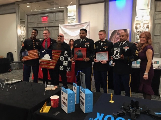 Perfectly Posh honored veterans at a special event before the 2019 Academy Awards with sponsor gift bags including Posh products and a product sampling bar.