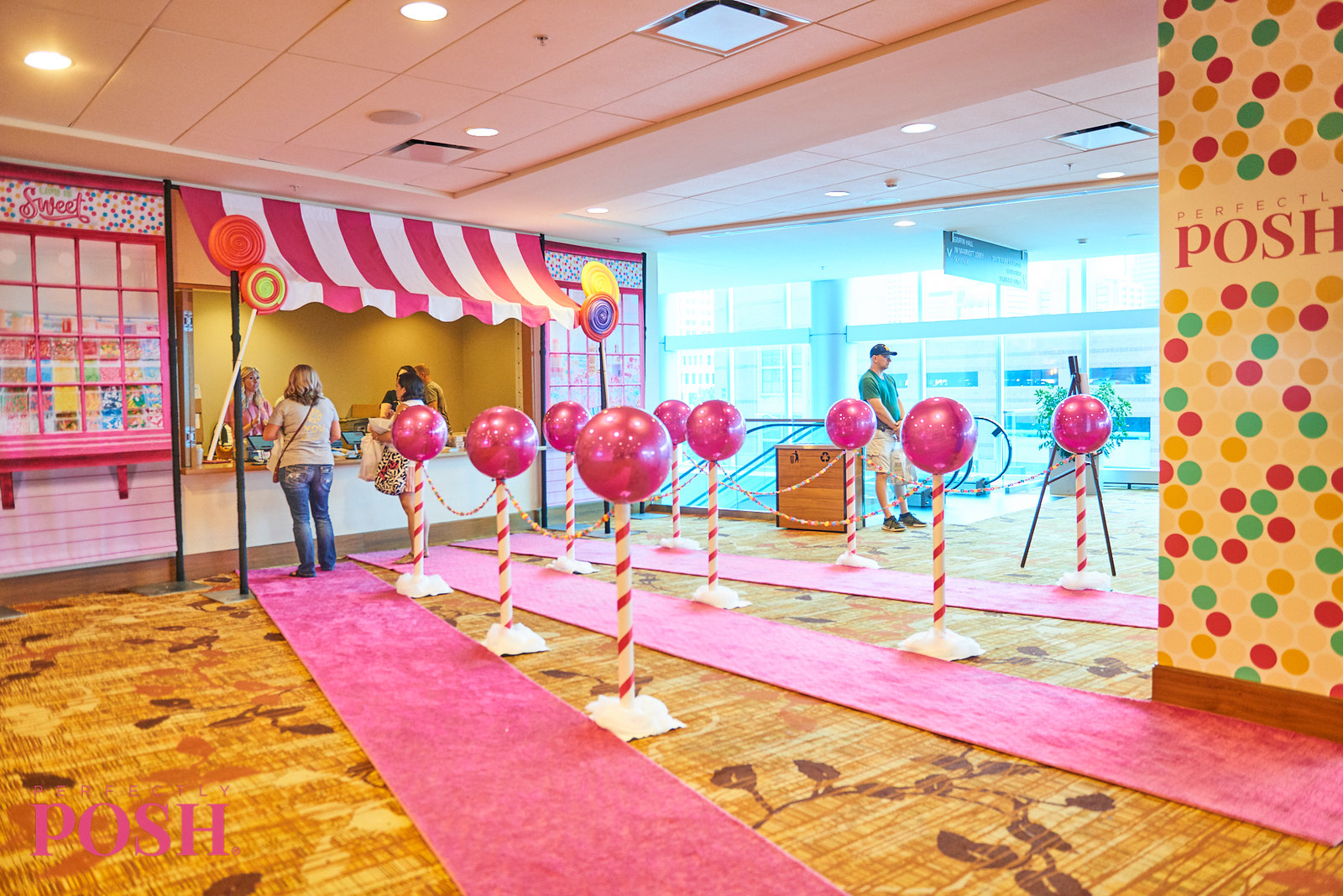 Perfectly Posh UnCon 2019 candy themed registration and check in booth