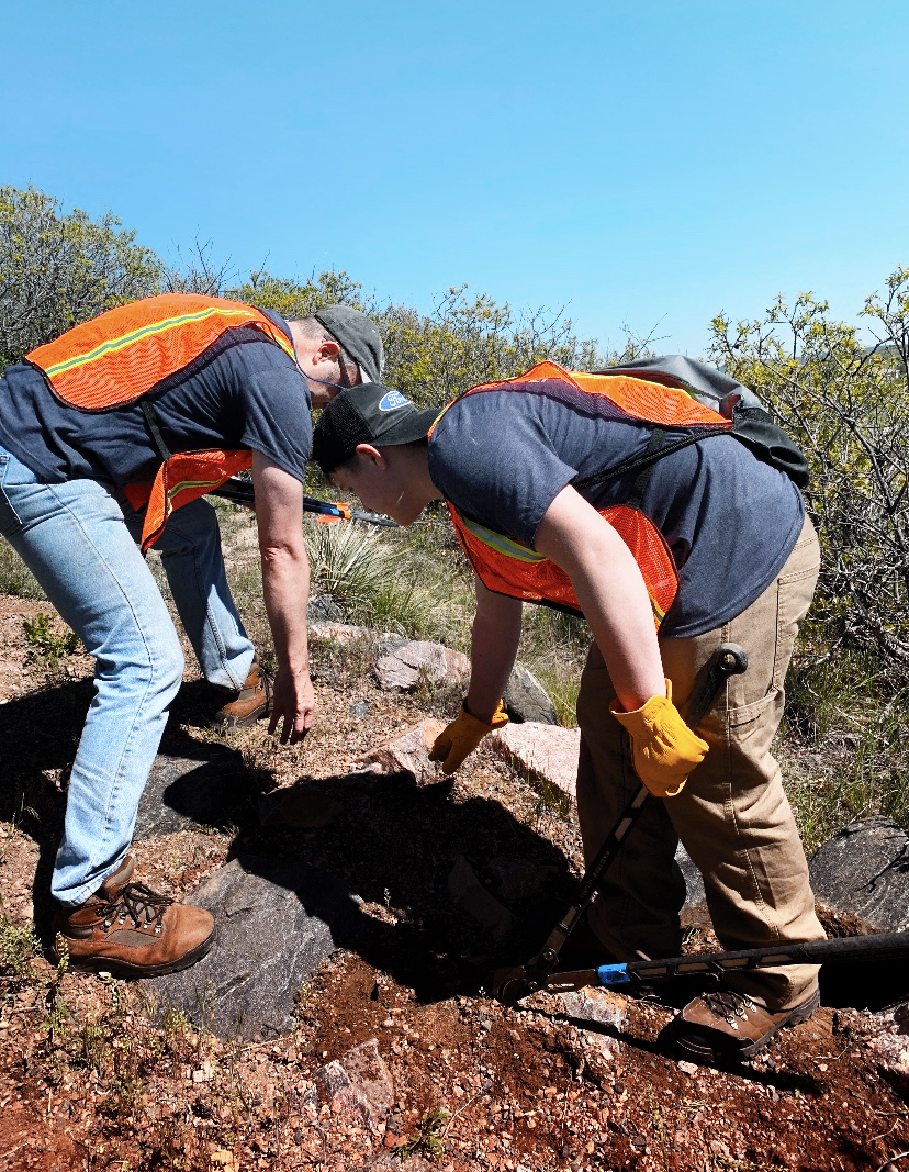 Jerry and Sam surveying some large rocks that need to be removed from the trail.