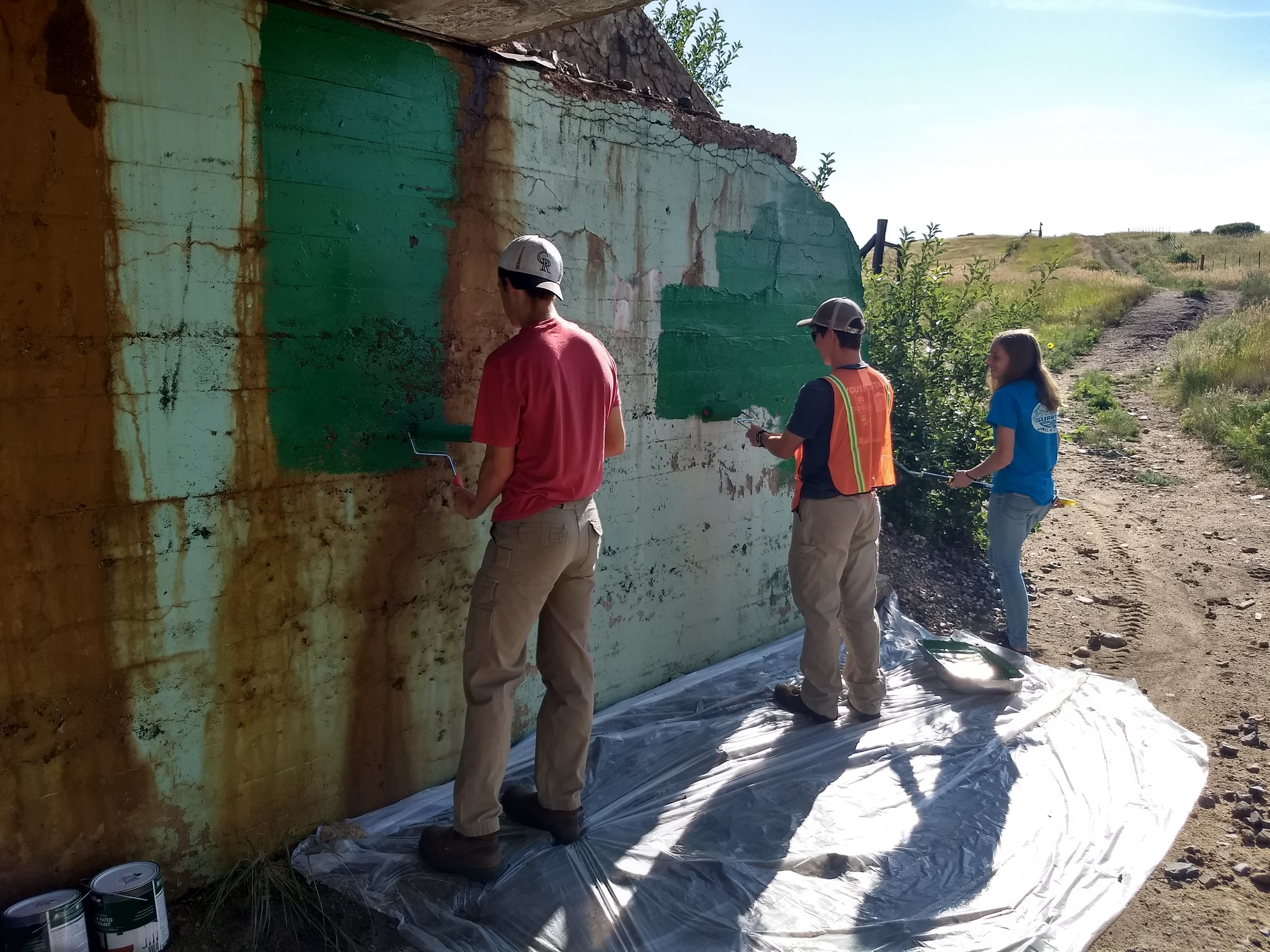 Ben, Sam and Avery painting the north wall.