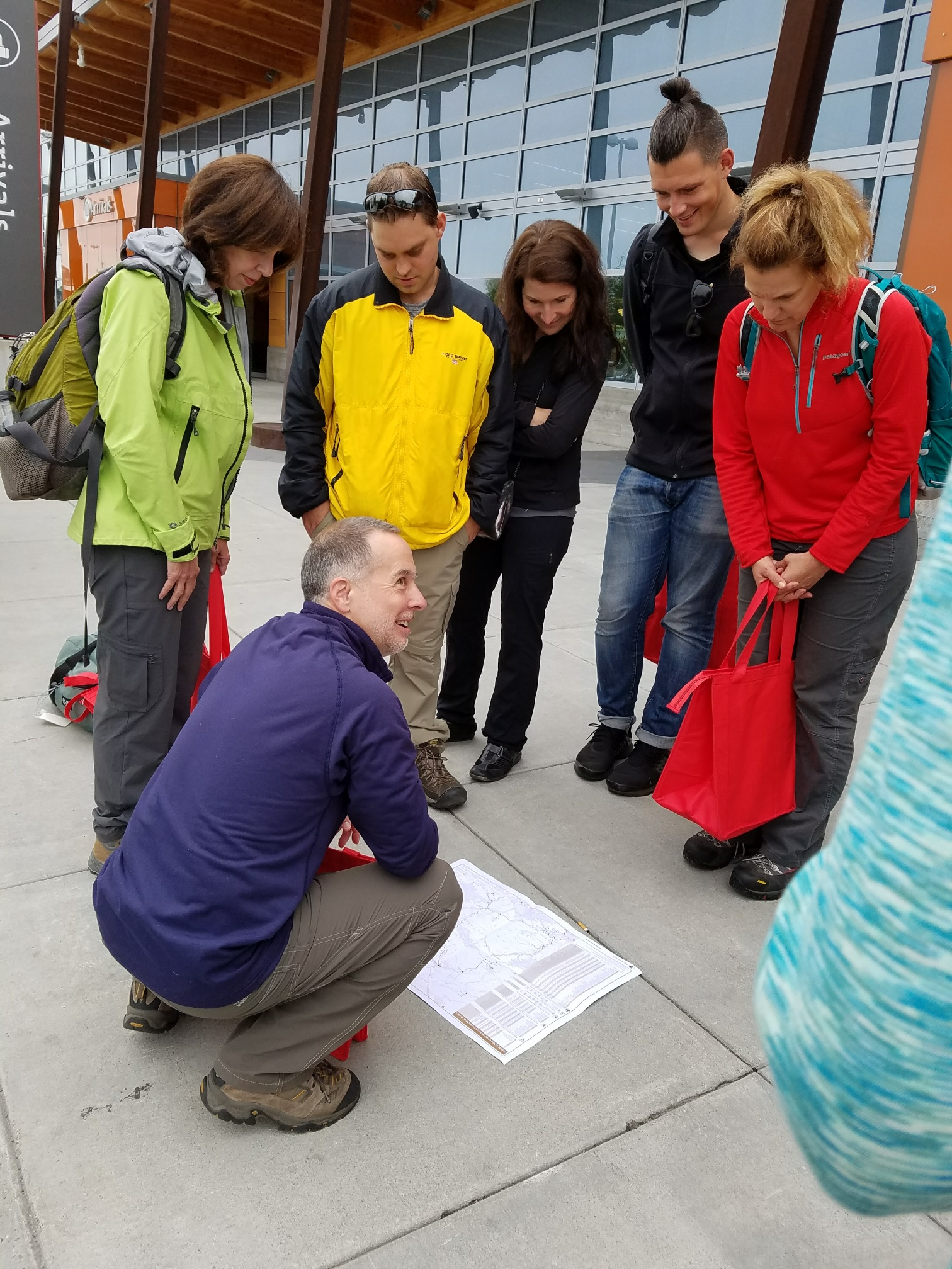 2017 Participants study a map on the first morning outside the Fairbanks Airport.