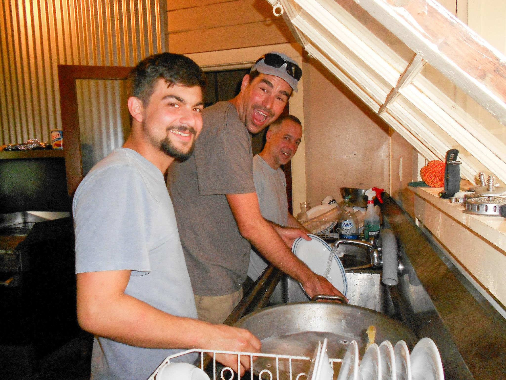 Cameron Dale, Cody Westheimer, and Stephen Lias wash the dishes at Coal Creek in 2015.