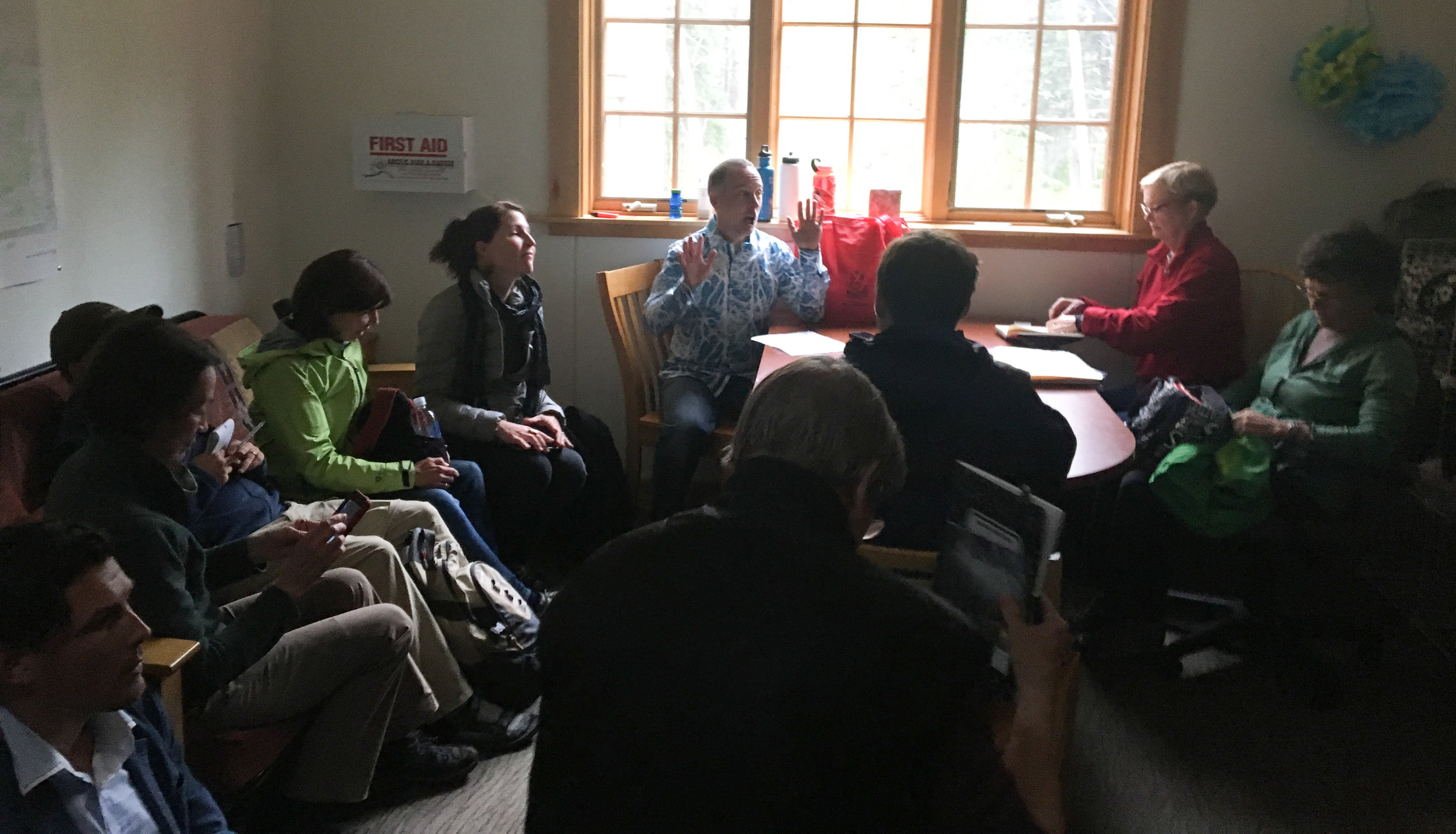 The composers and artist meet for the first time in a back room at the Denali Visitors Center.