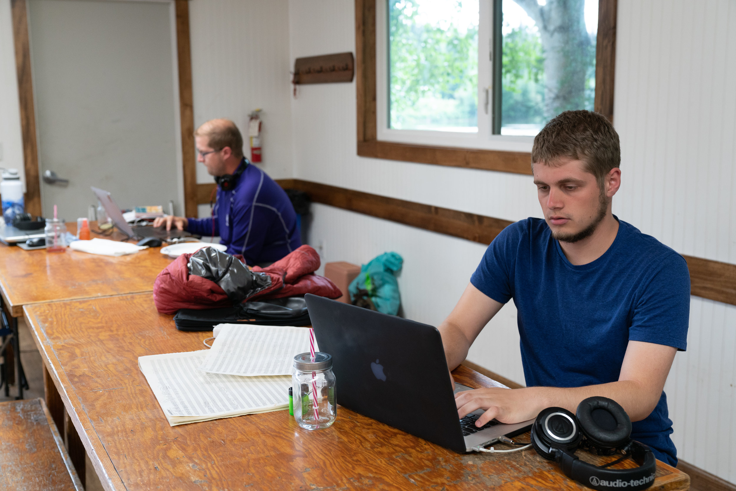 2018 participants working on their pieces in the mess hall at Twin Bears.